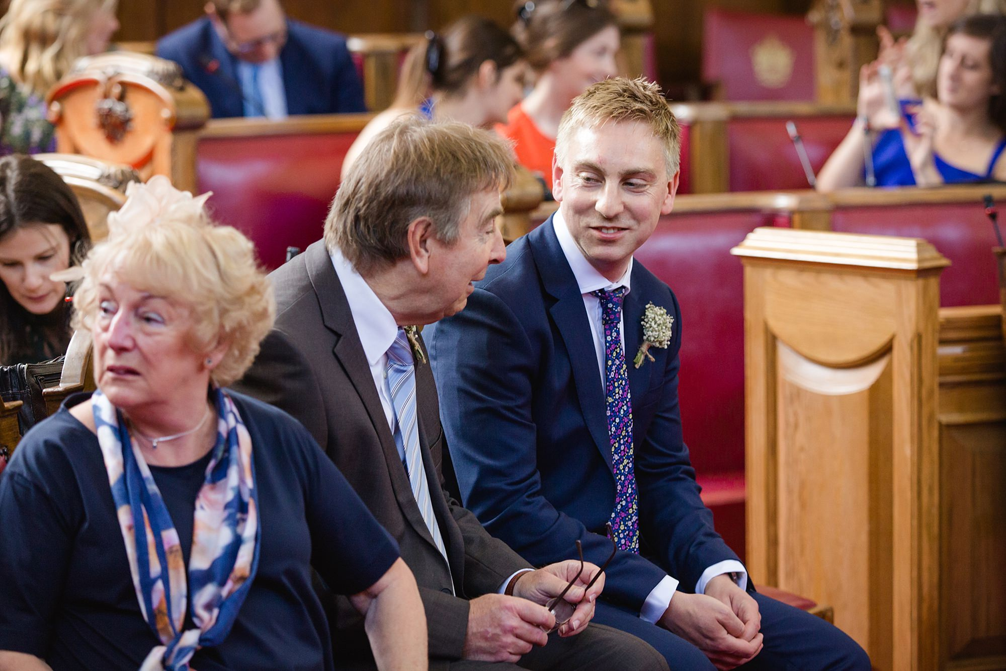 oyster shed wedding portrait of groom and his family waiting at islington town hall