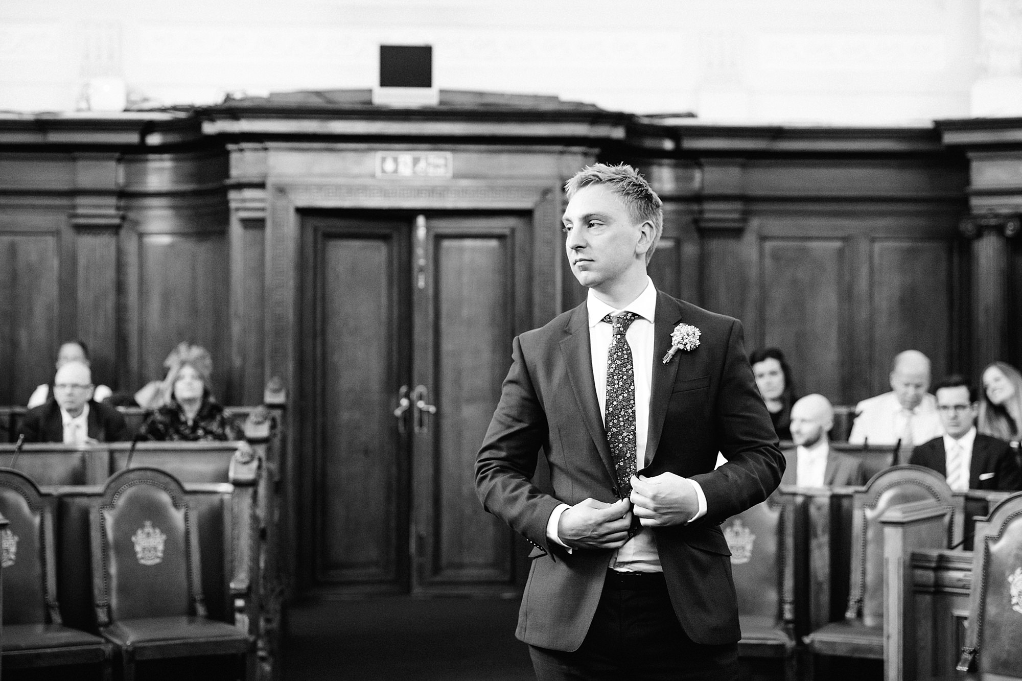 oyster shed wedding groom waits for his bride at islington town hall