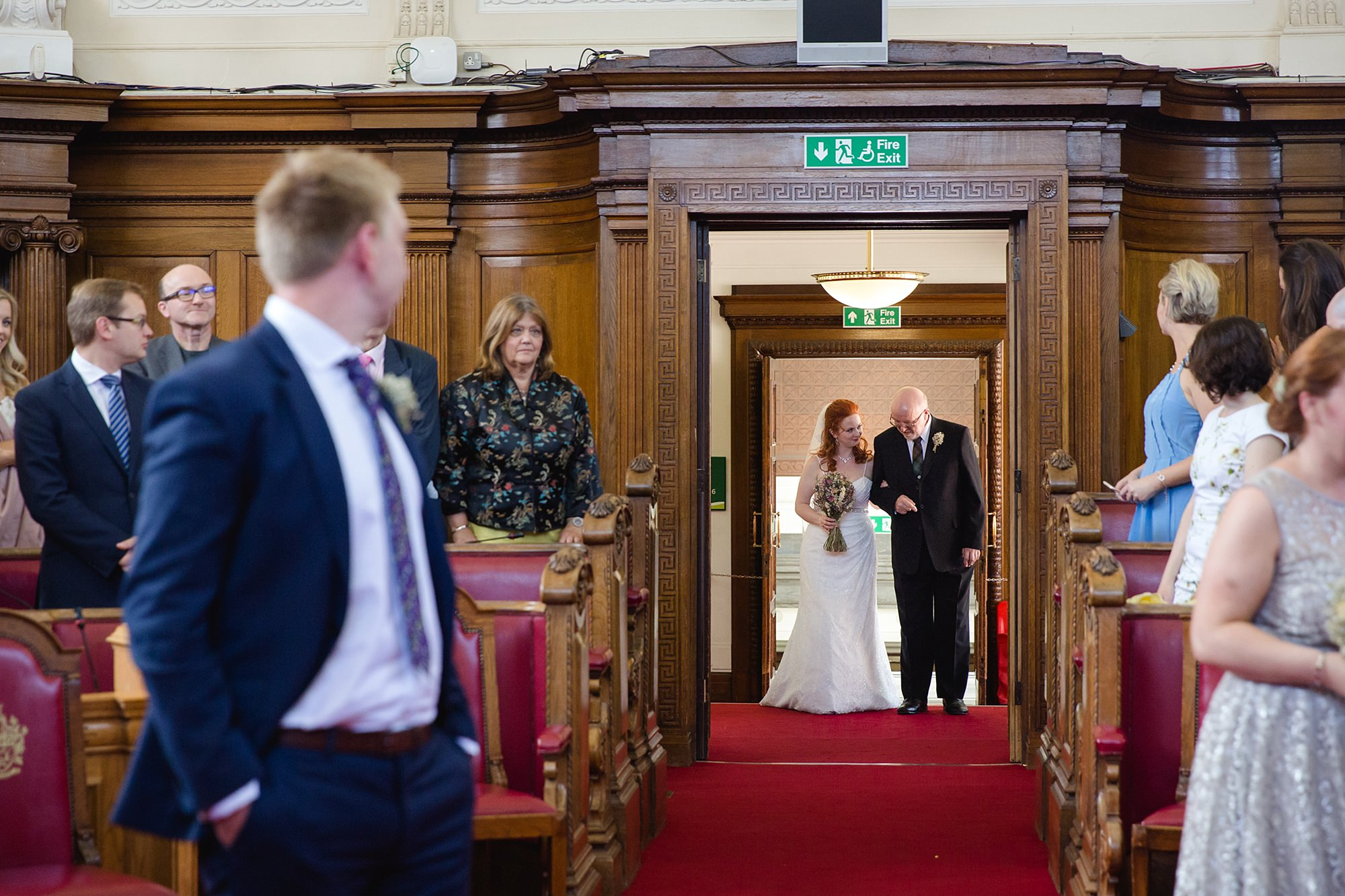 oyster shed wedding bride enters for islington town hall wedding ceremony