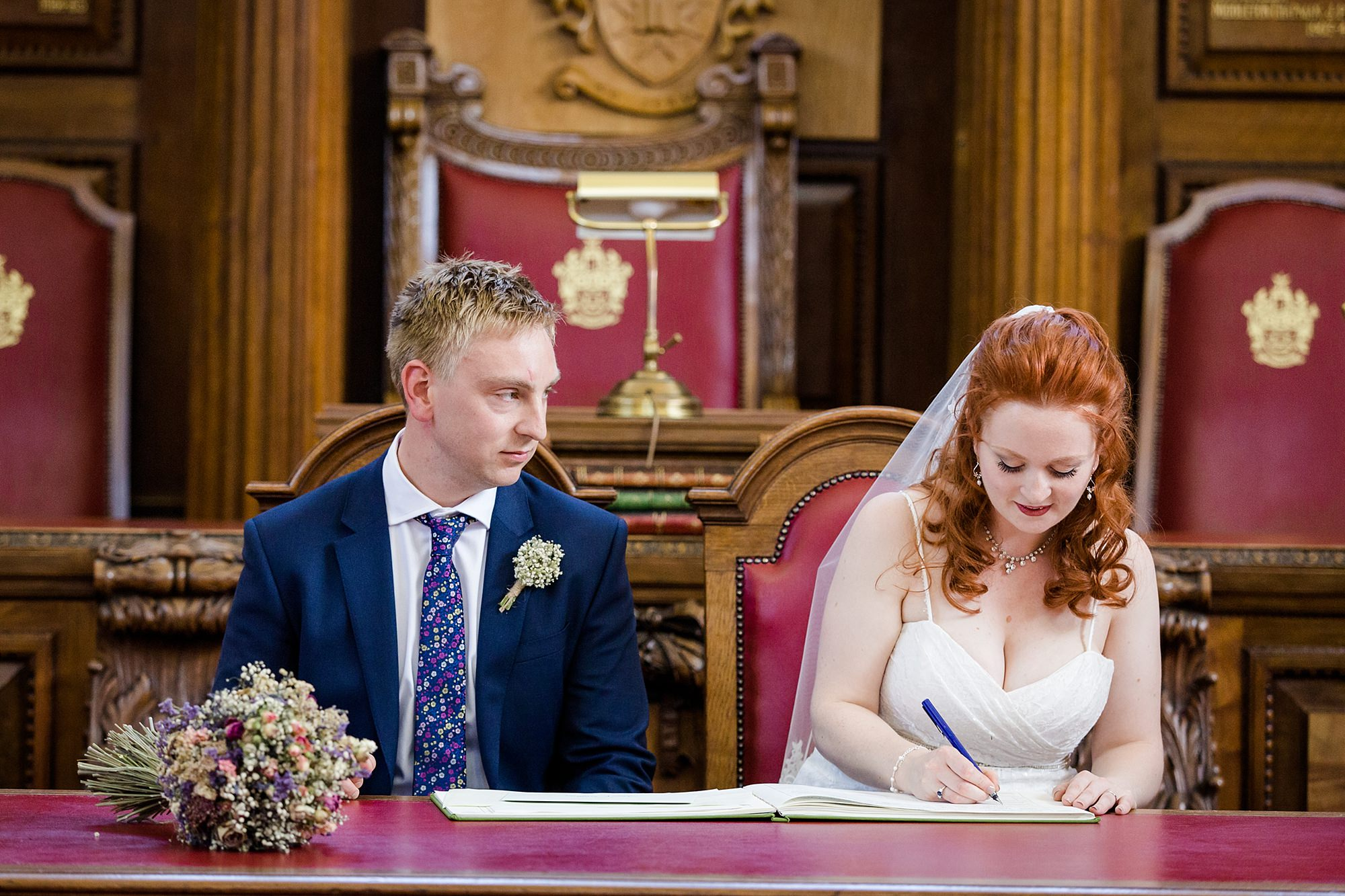 oyster shed wedding bride and groom sign register at islington town hall wedding