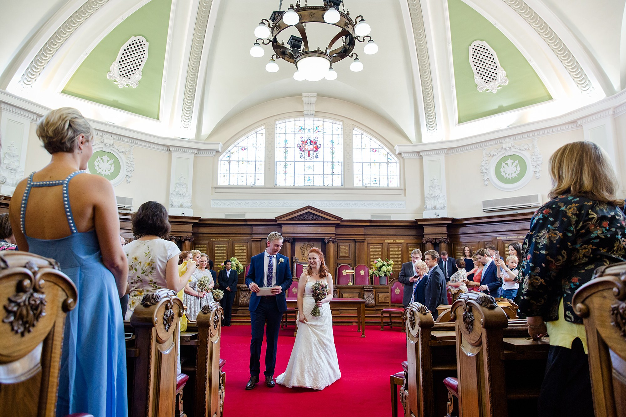 oyster shed wedding bride and groom exit wedding ceremony at islington town hall