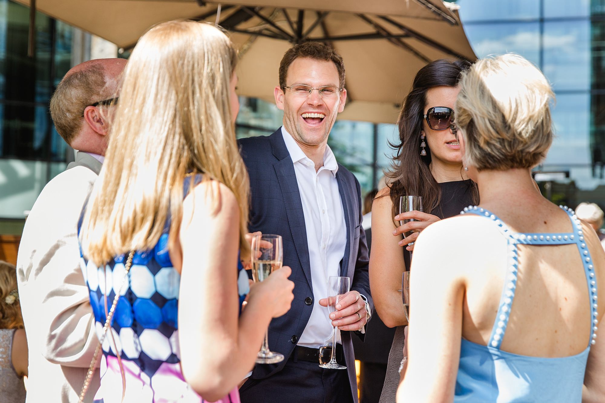 oyster shed wedding guests laughing together