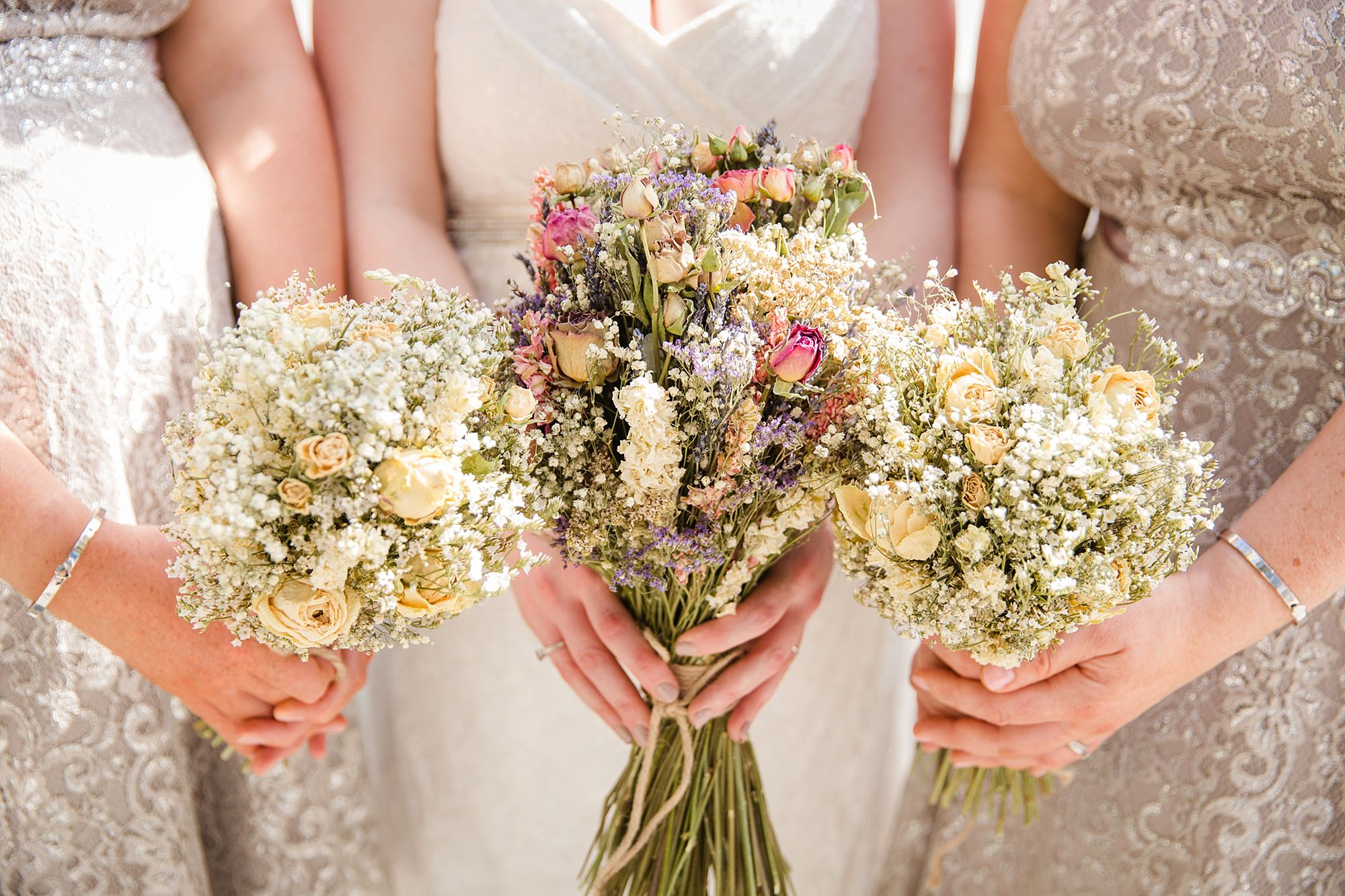 oyster shed wedding close up of bride and bridesmaids dried bouquets