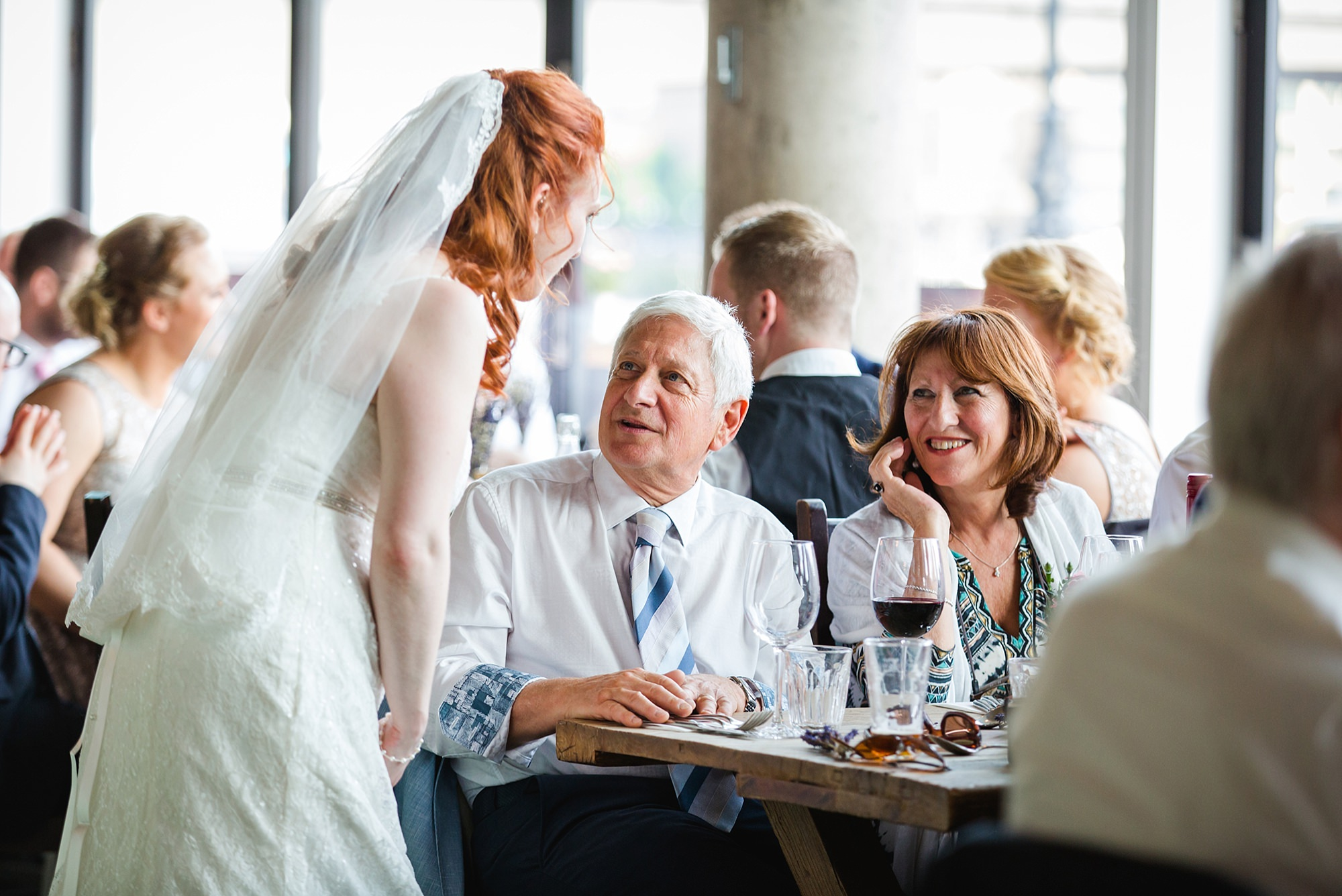 oyster shed wedding portrait of bride chatting to guests