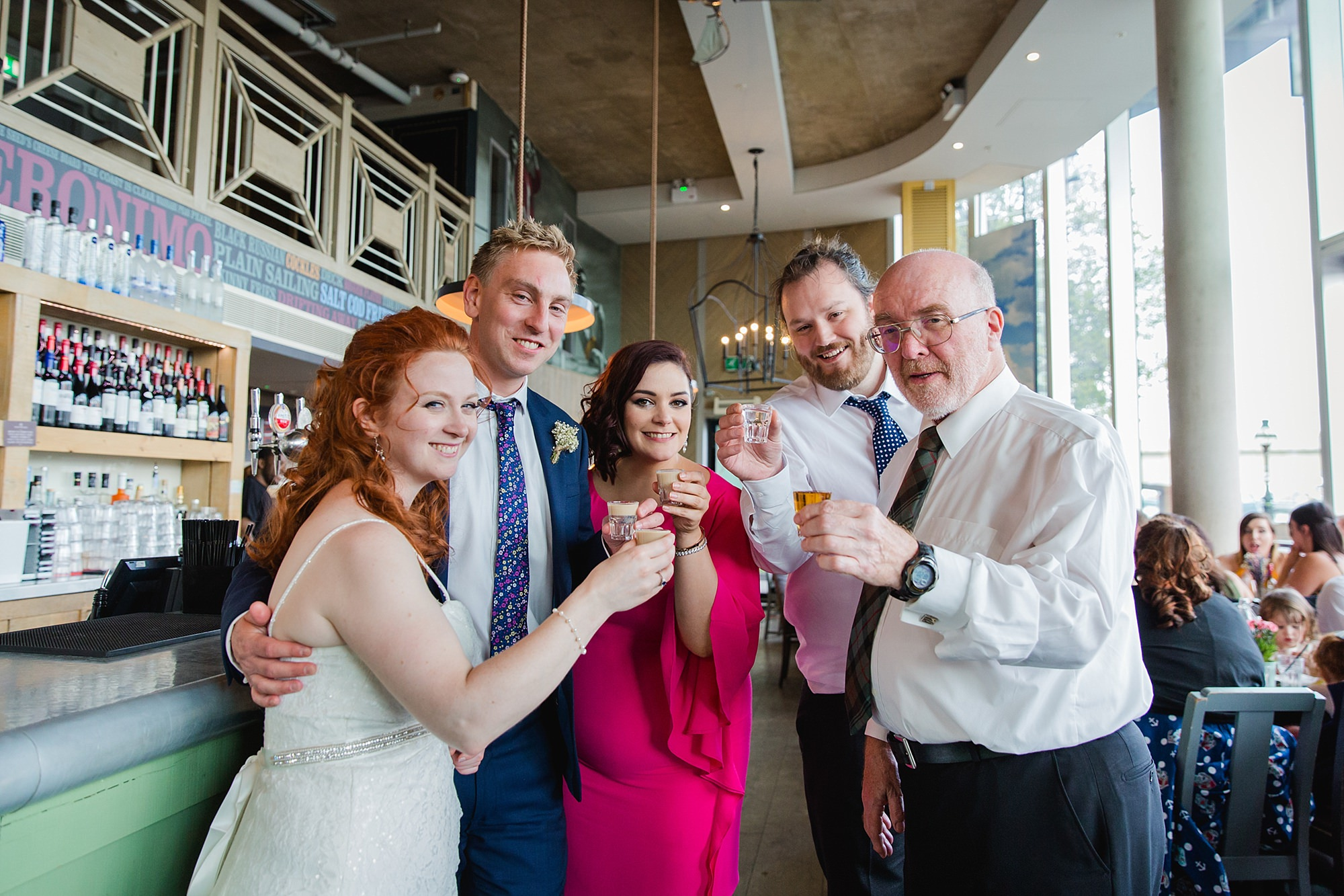 oyster shed wedding guests toast before doing shots