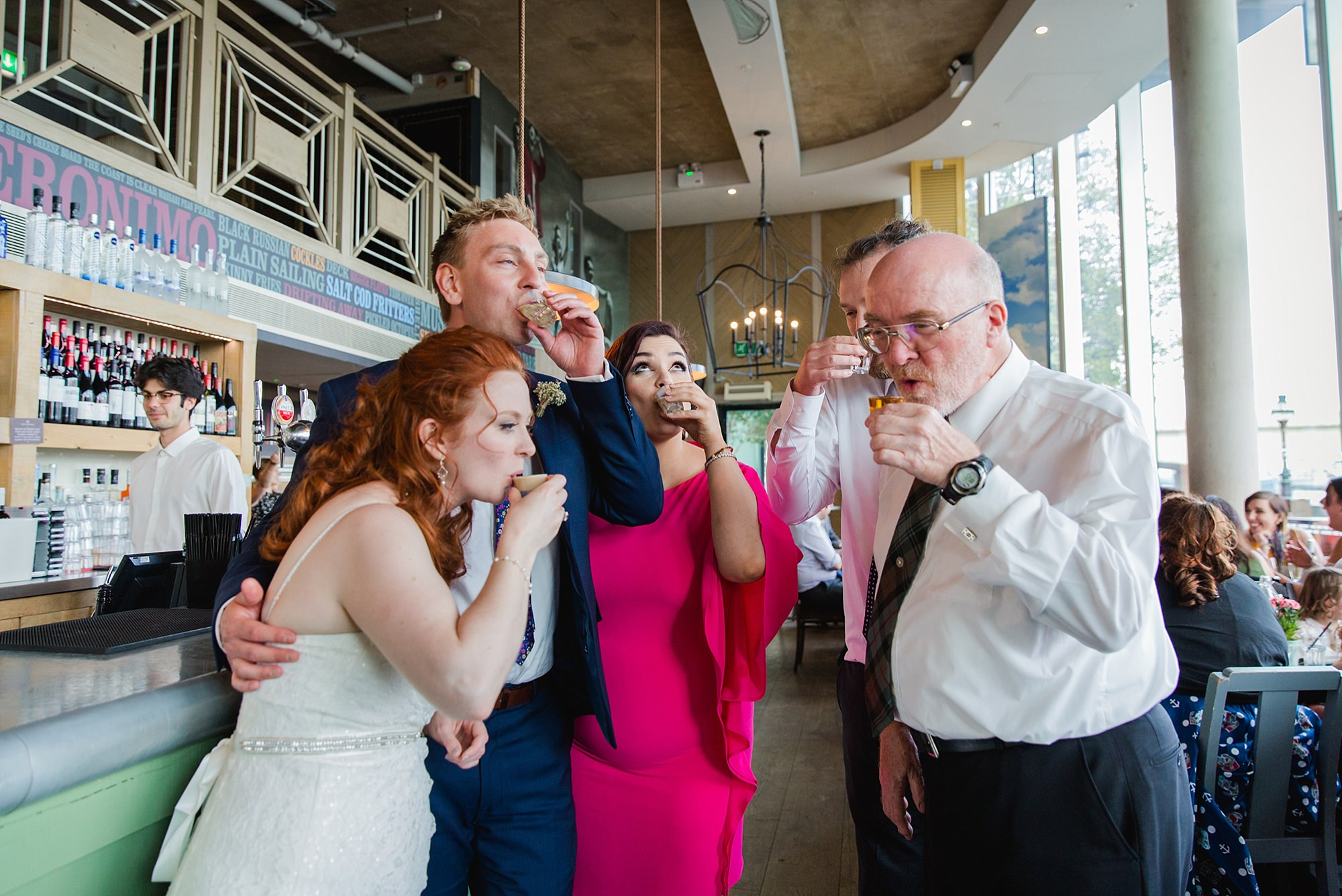 oyster shed wedding guests do shots together