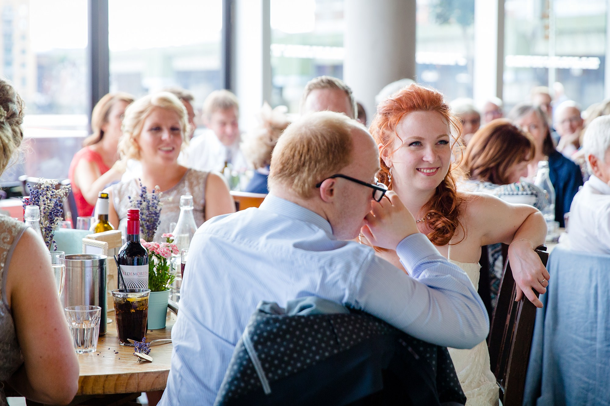 oyster shed wedding bride smiles at her father during speeches