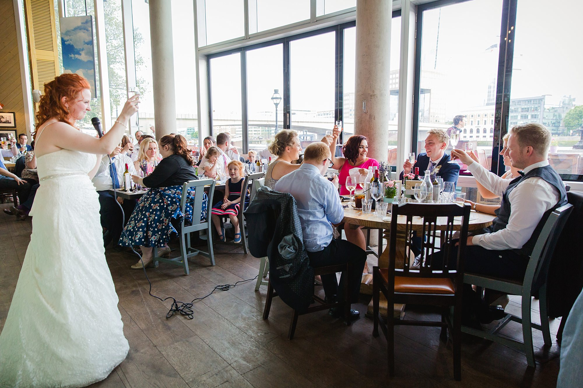 oyster shed wedding bride and guests toast together