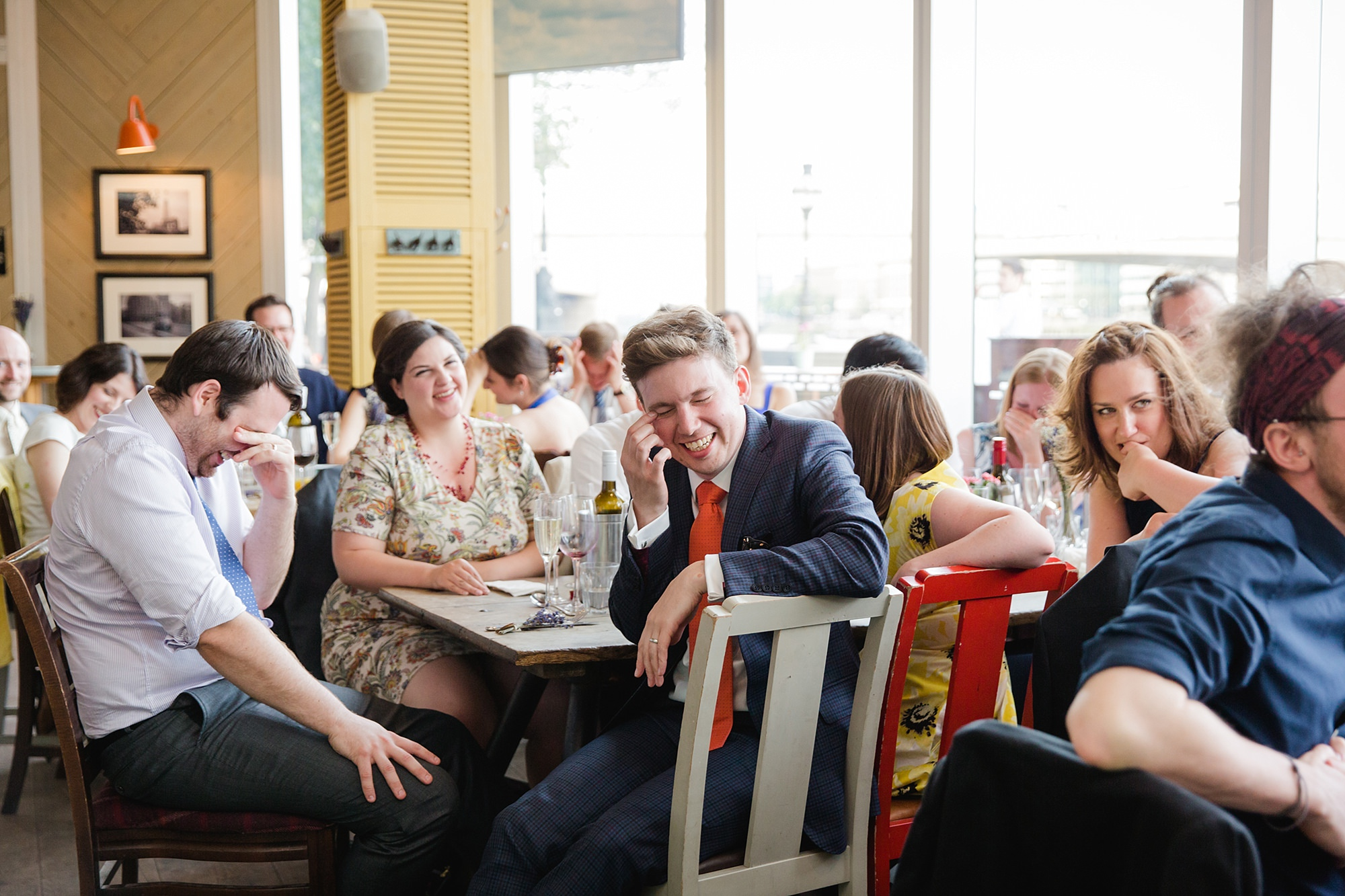 oyster shed wedding guests laughing at groom's speech
