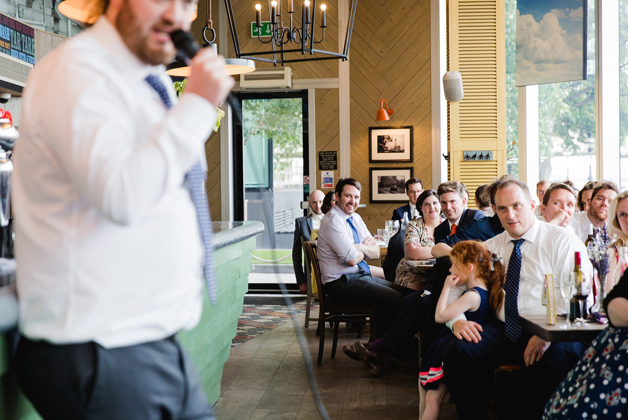oyster shed wedding guests laugh at best man's speech