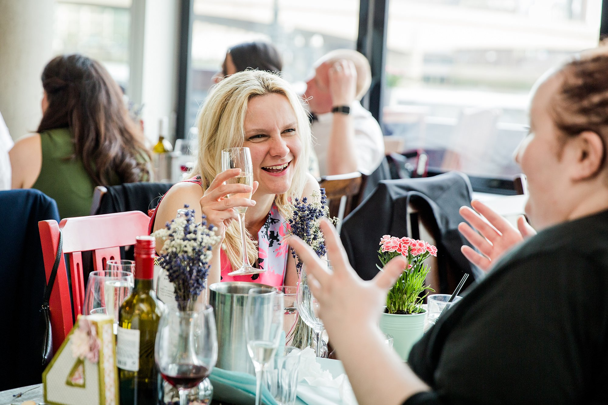 oyster shed wedding guests chatting together