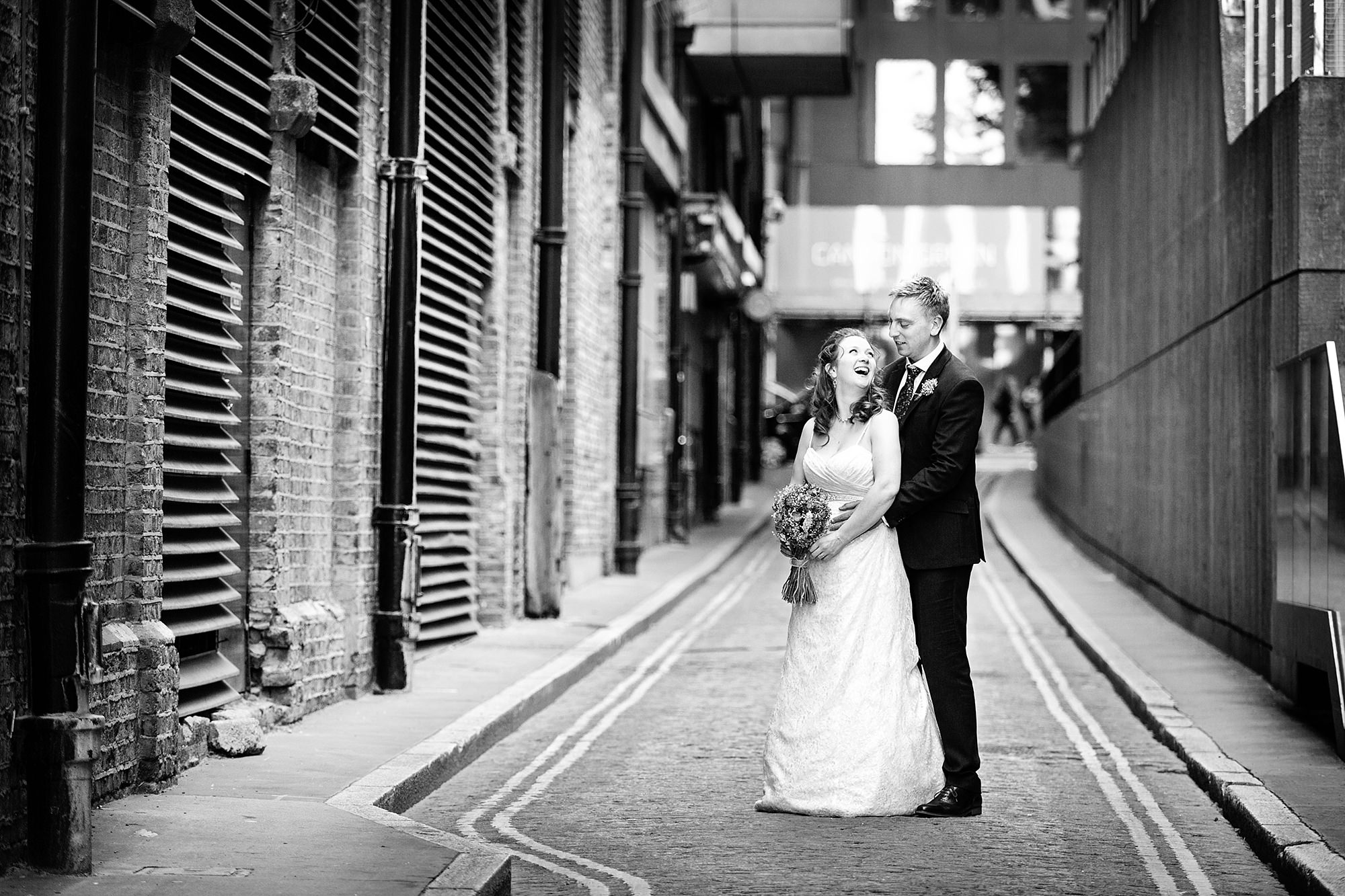 oyster shed wedding bride and groom laugh together
