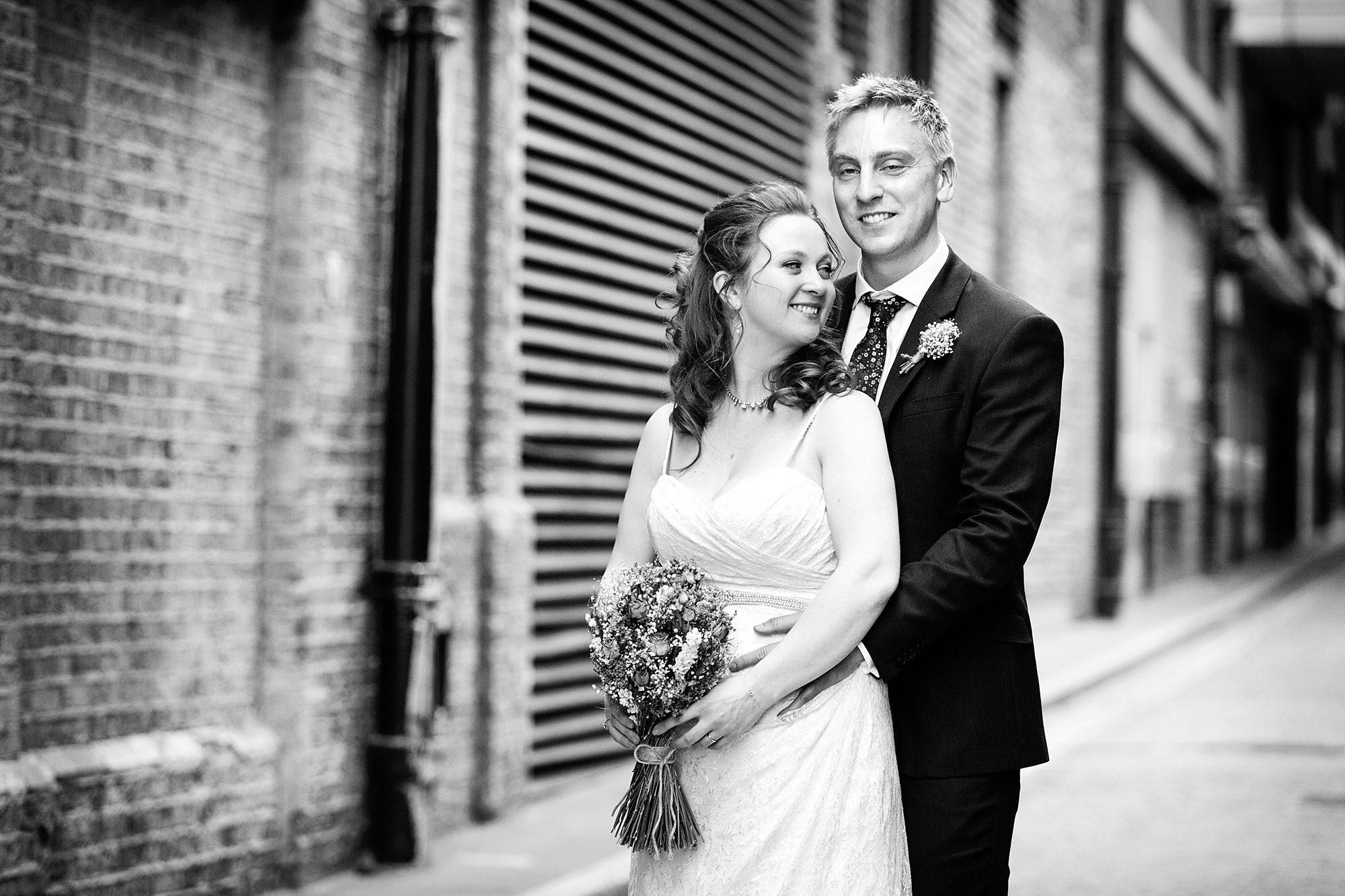 oyster shed wedding happy portrait of bride and groom