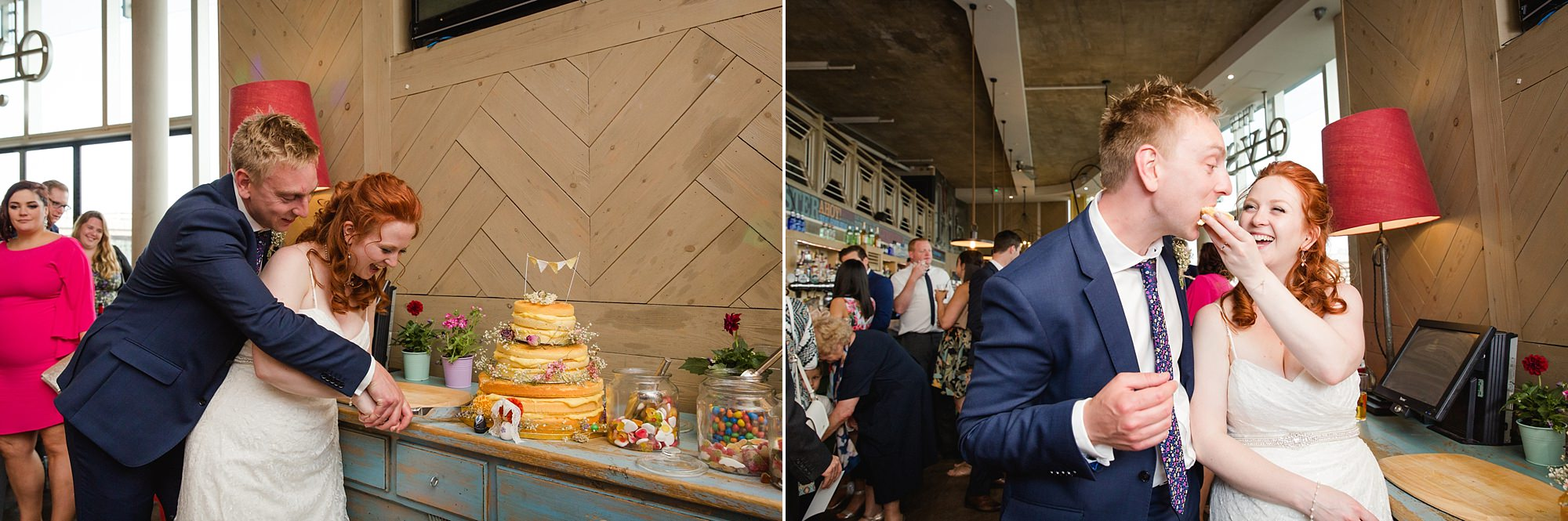oyster shed wedding fun portrait of bride and groom cutting cake