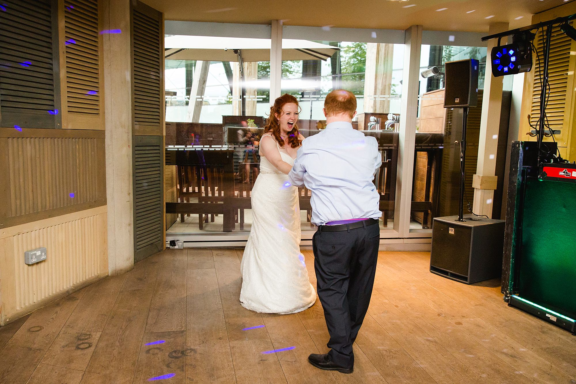 oyster shed wedding bride and guests dancing