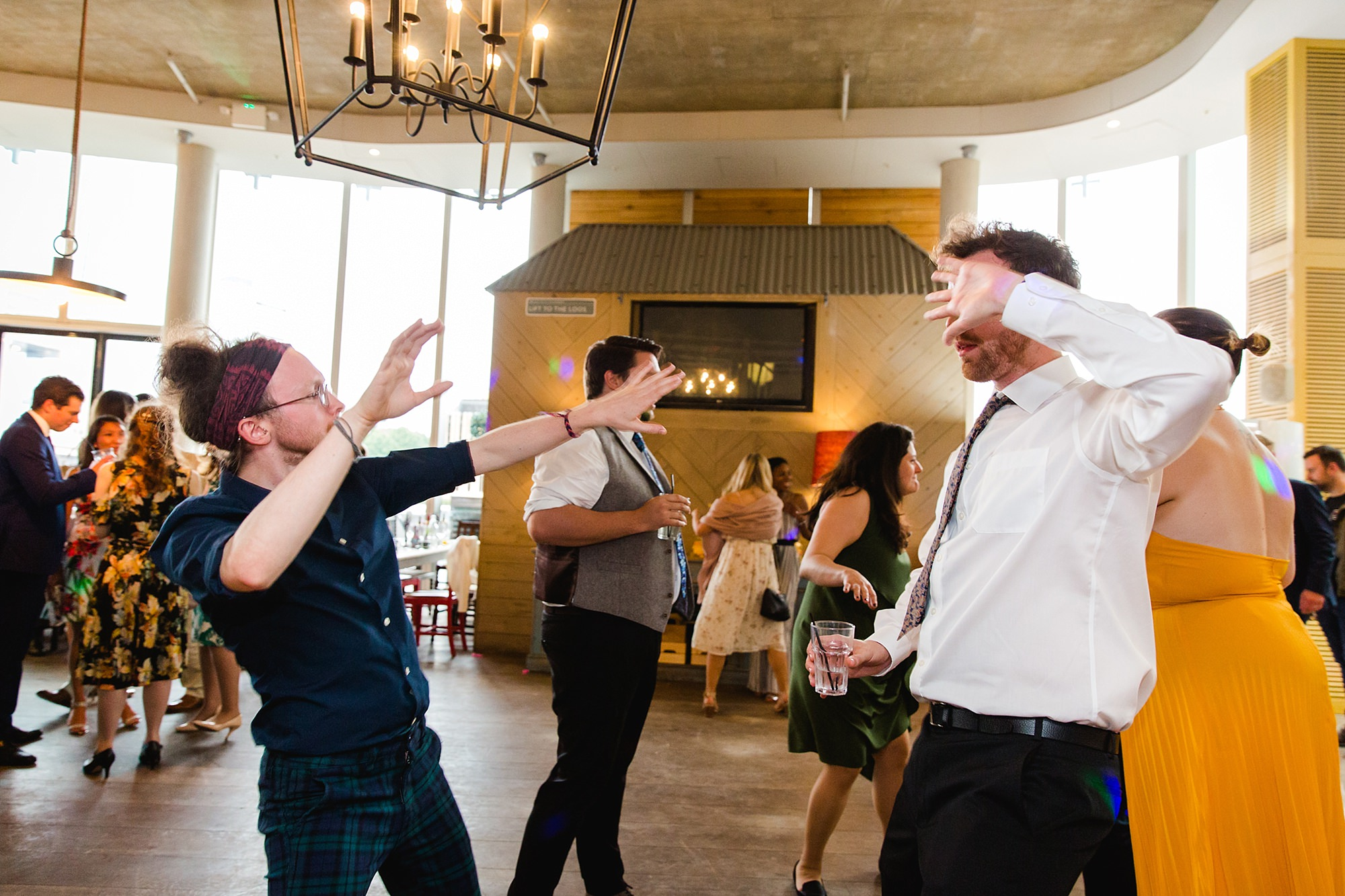 oyster shed wedding guests dance together