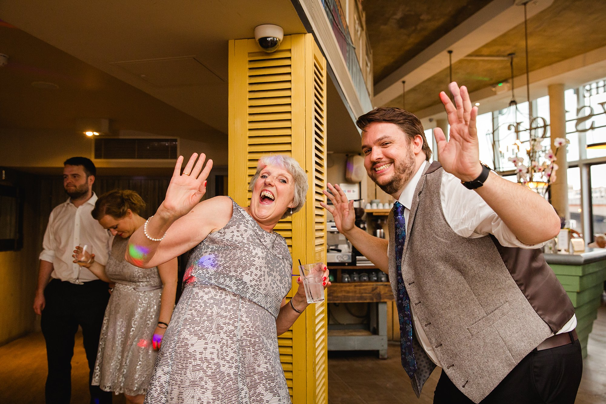 oyster shed wedding laughing guests dancing