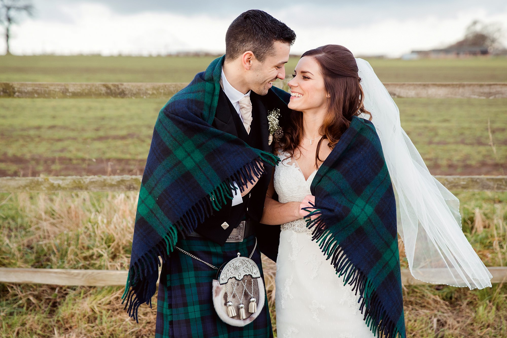 swancar farm wedding photography bride and groom with tartan shawl