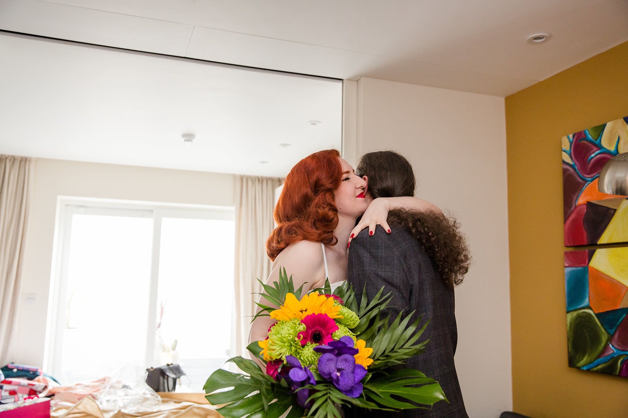 The Grange Ealing wedding bride hugs groom ahead of ceremony