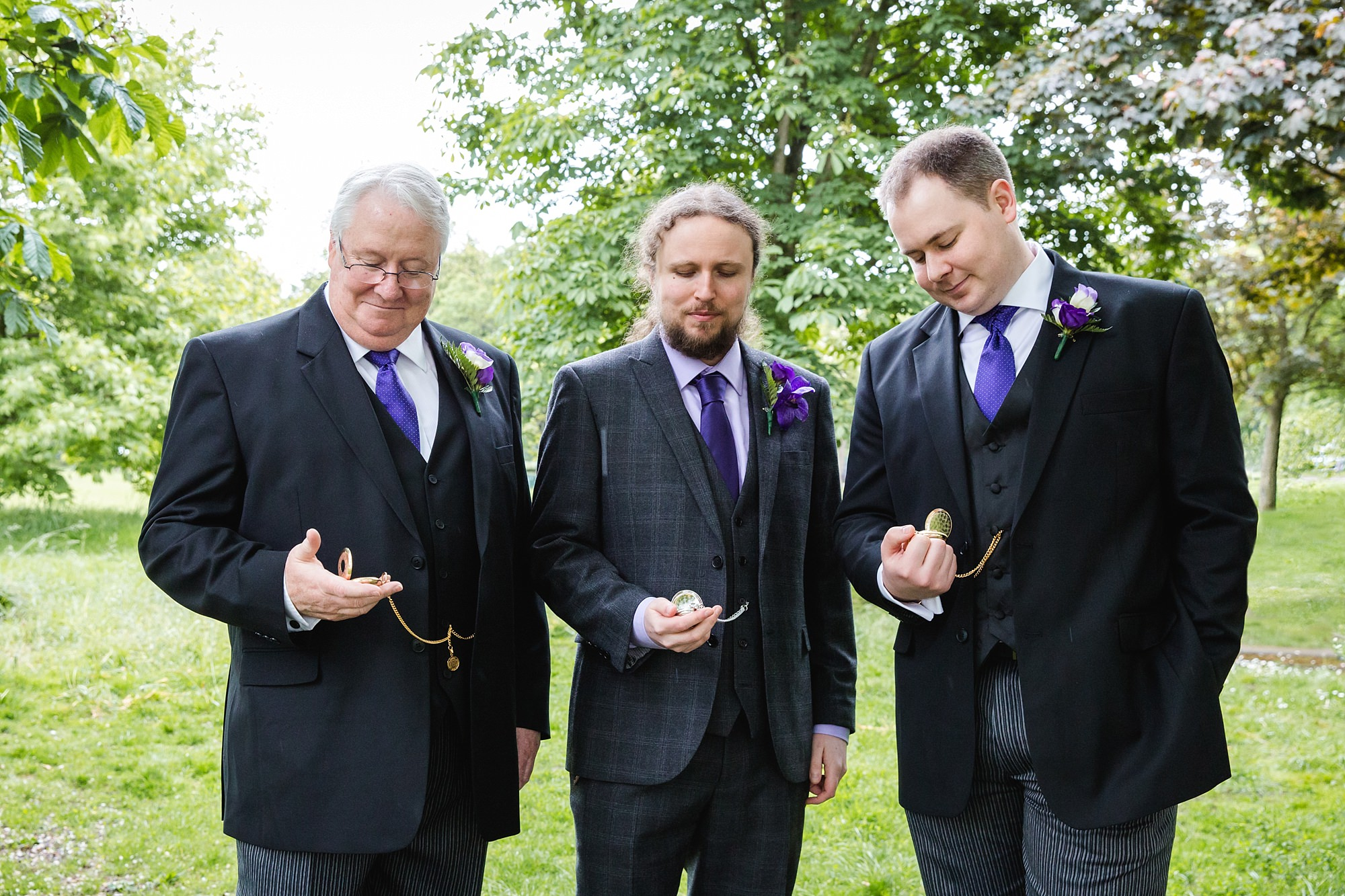 The Grange Ealing wedding groom and groomsmen with pocket watches