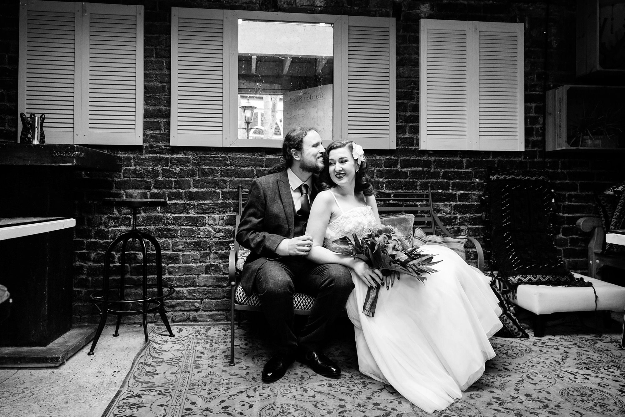 The Grange Ealing wedding portrait of groom and bride kissing