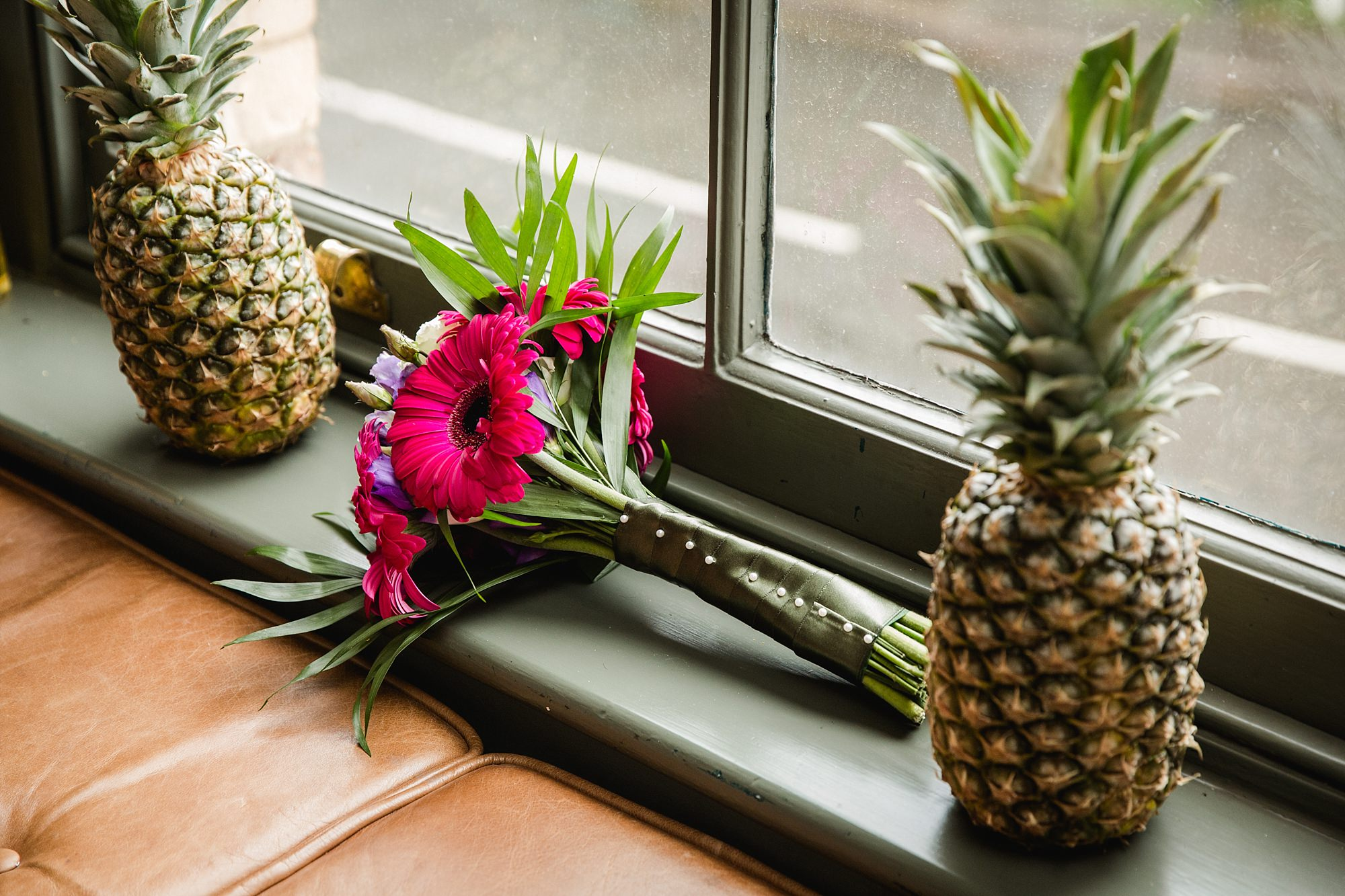 The Grange Ealing wedding bride's tropical bouquet with pineapples