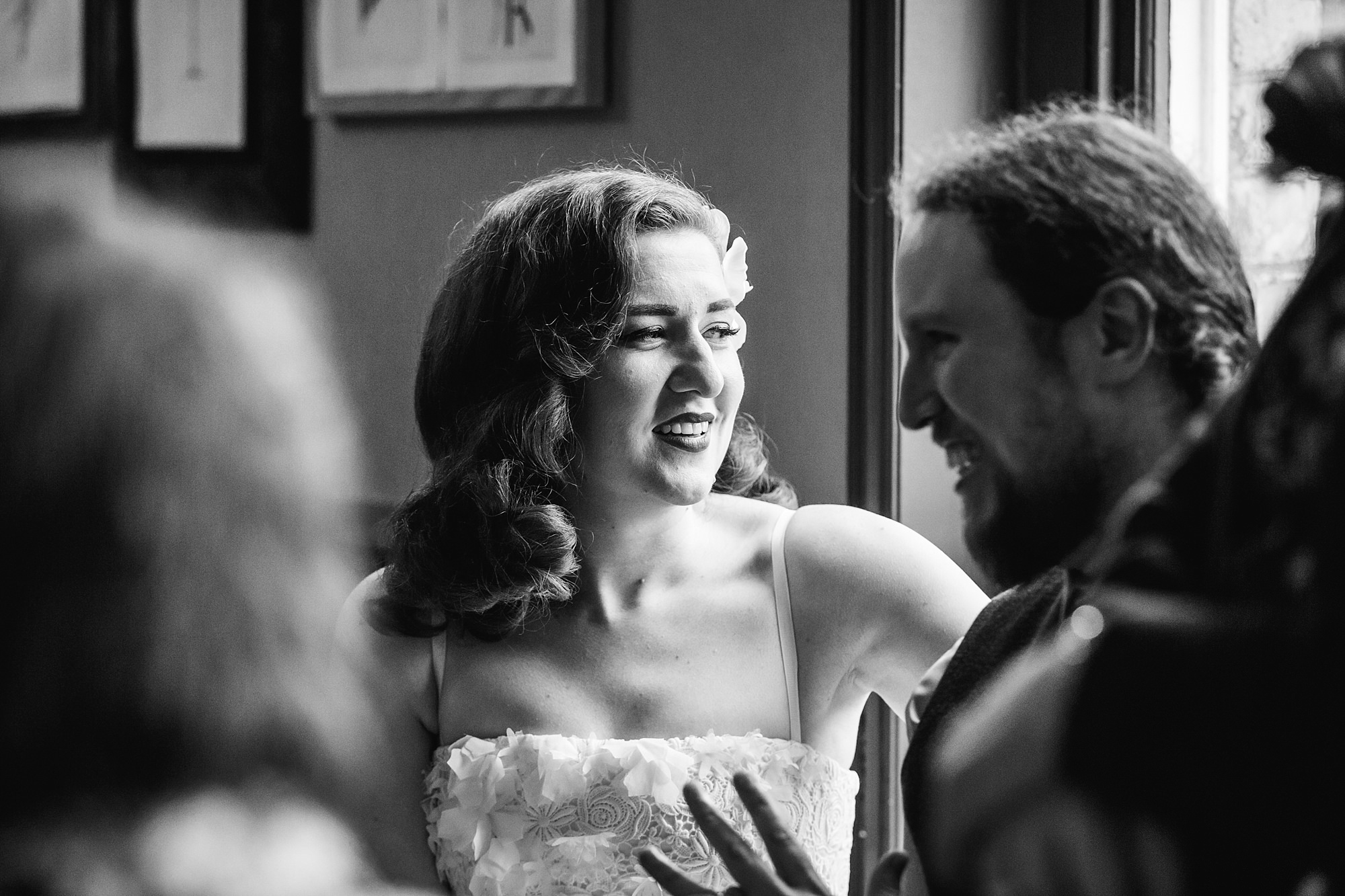 The Grange Ealing wedding bride and groom laugh together during dinner