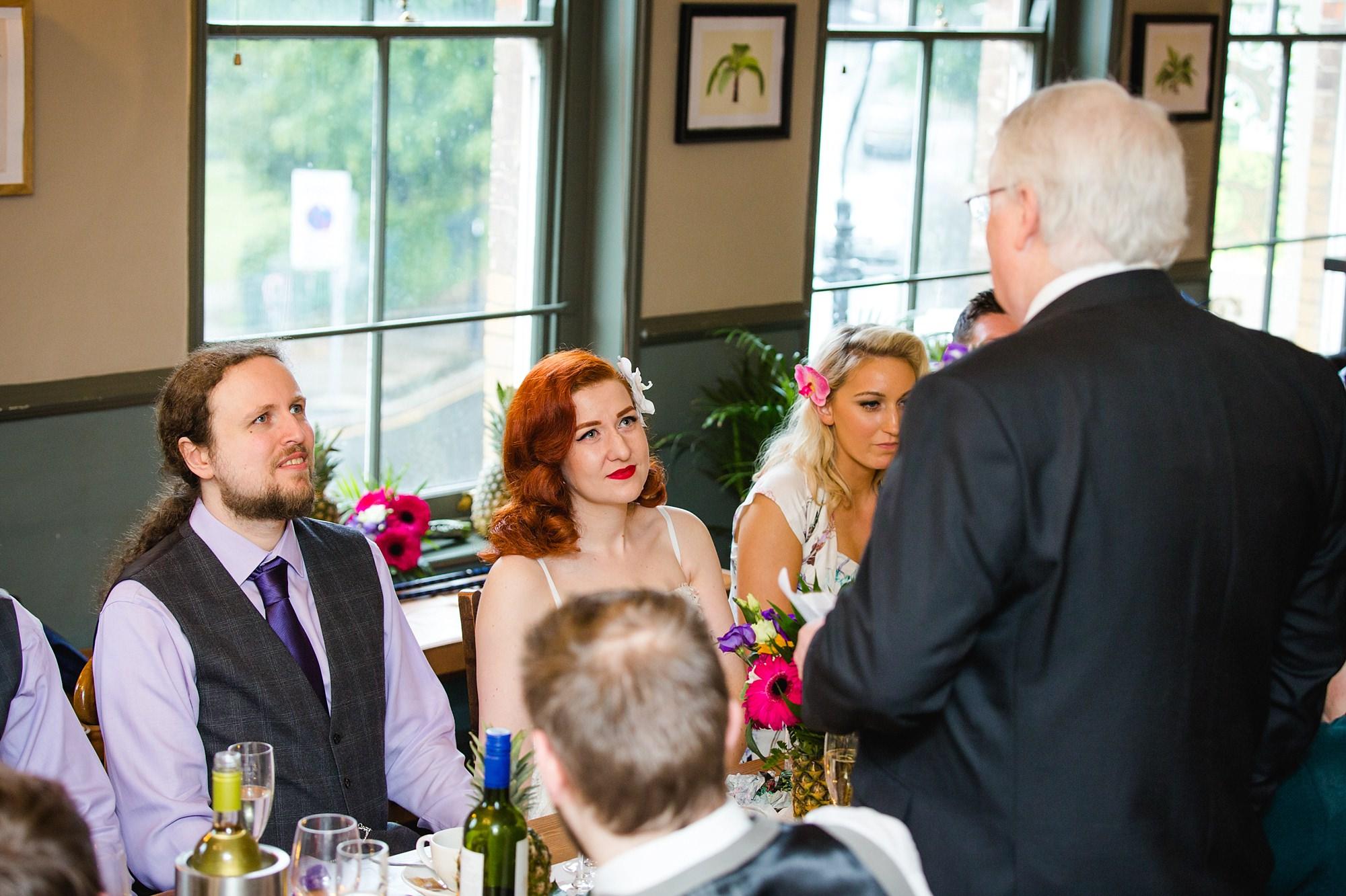 The Grange Ealing wedding bride and groom listen to speech