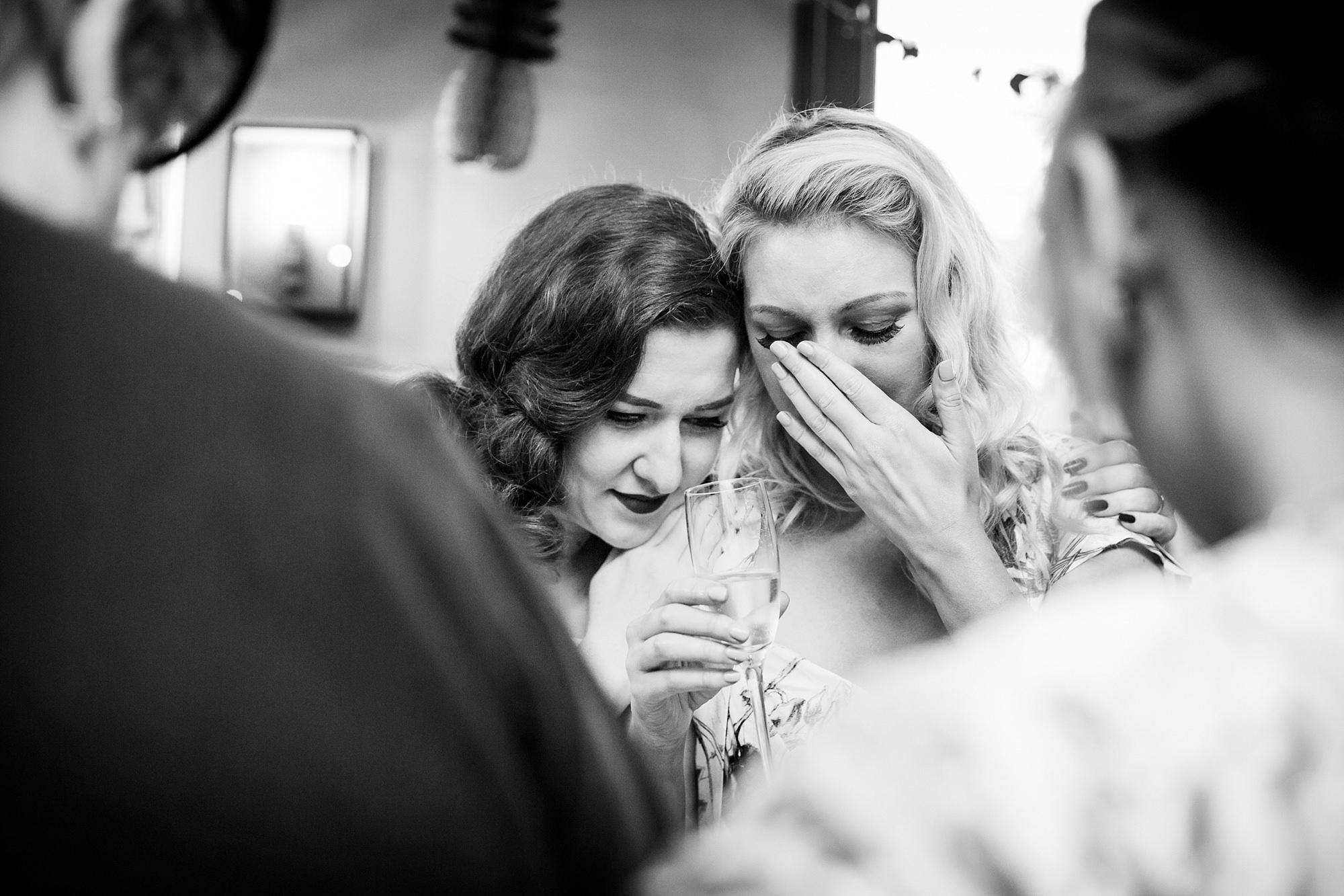 The Grange Ealing wedding bride hugs brides aids after her speech