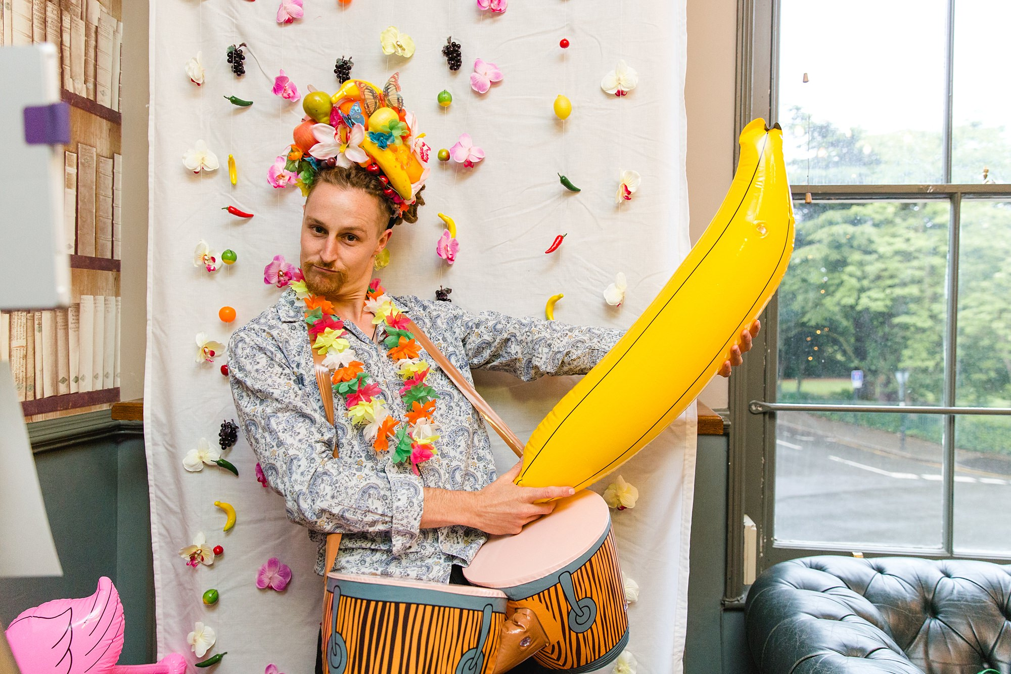The Grange Ealing wedding fun portrait of guest with inflatable banana