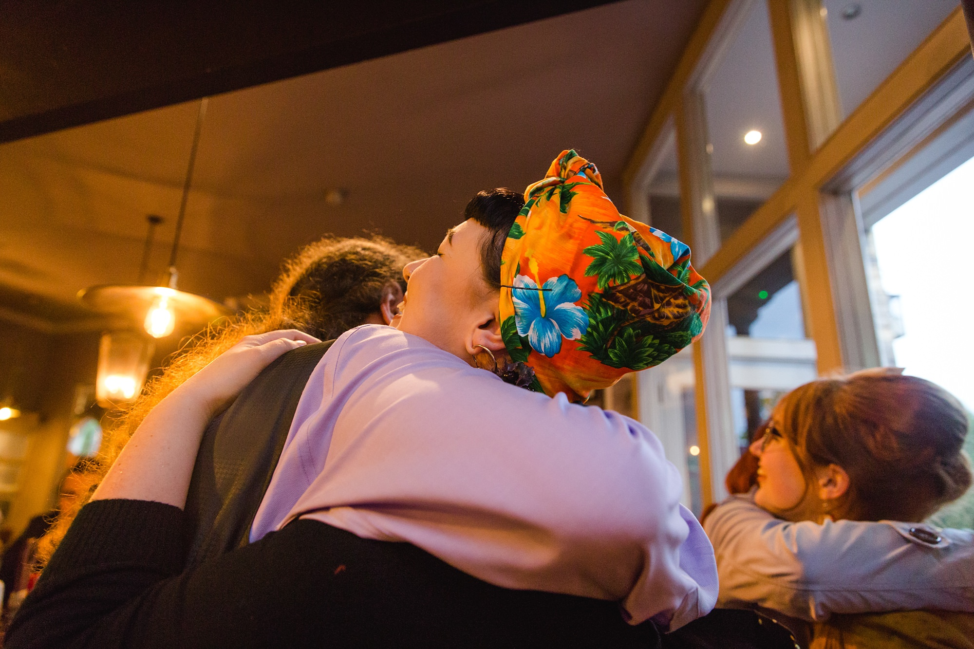 The Grange Ealing wedding guest hugging groom