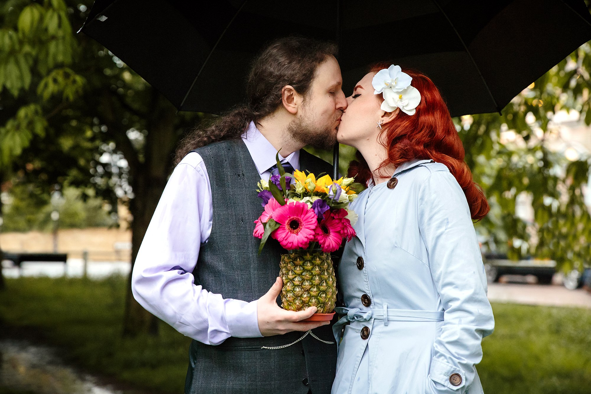 The Grange Ealing wedding bride and groom under umbrella