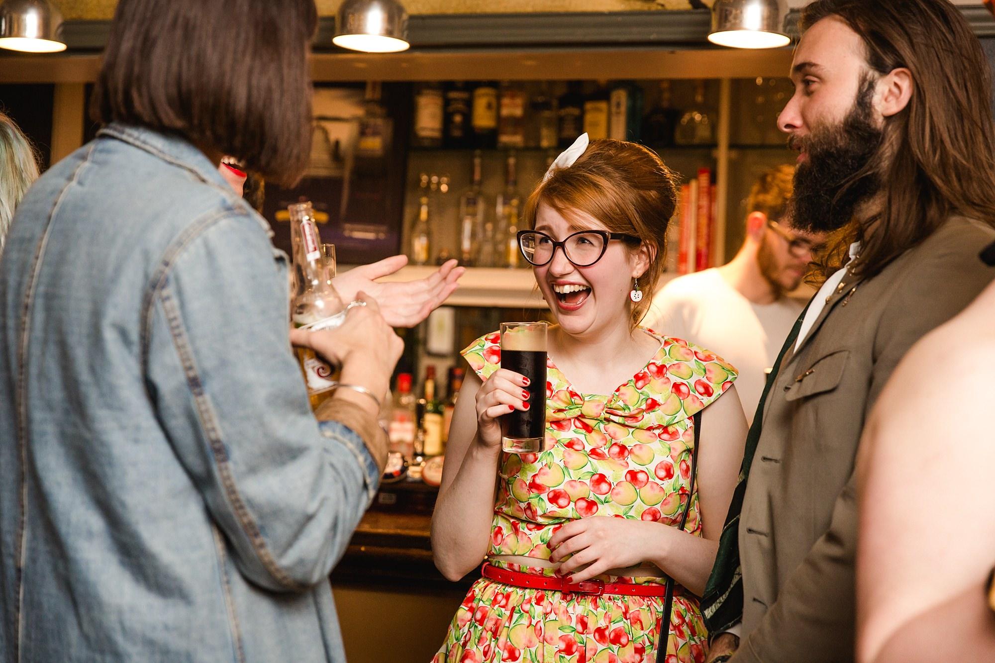 The Grange Ealing wedding guests laughing