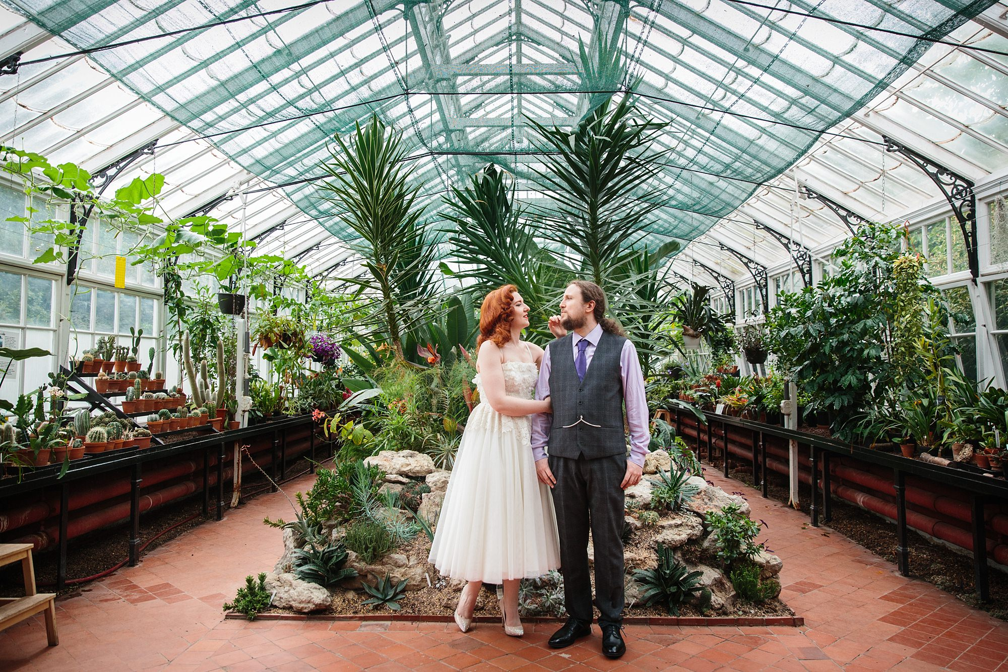 tropical wedding shoot bride and groom in conservatory