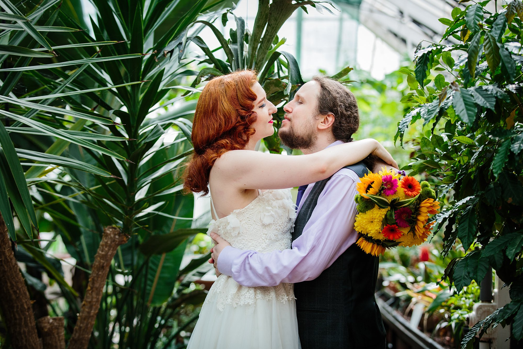 tropical wedding shoot bride and groom amongst tropical plants