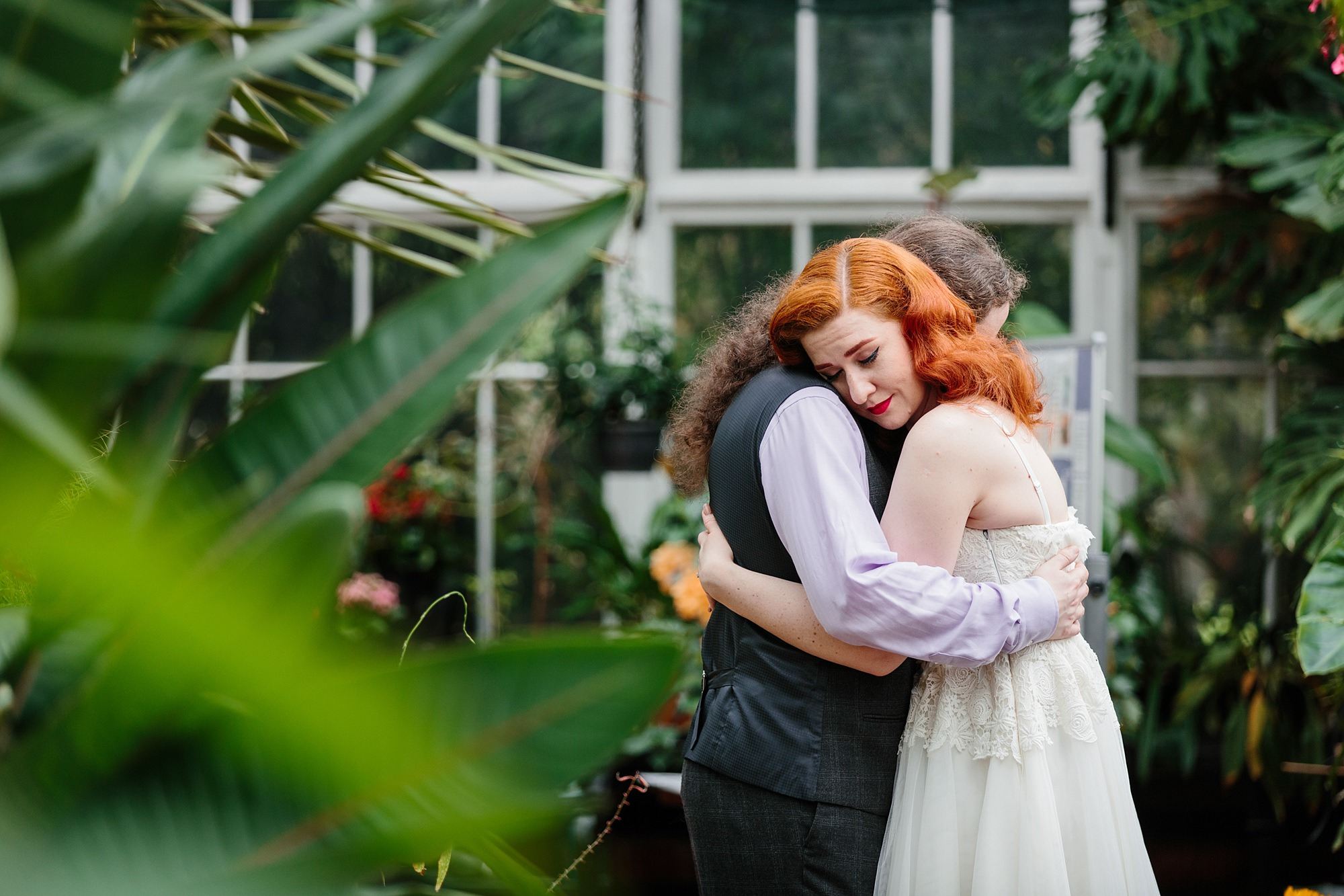 tropical wedding shoot bride and groom in a conservatory