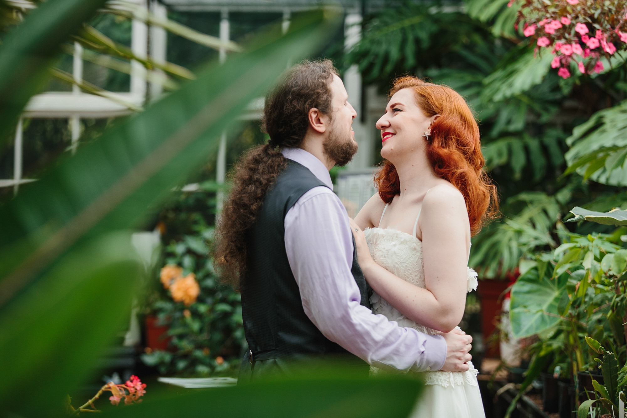 tropical wedding shoot bride and groom in tropical leaves