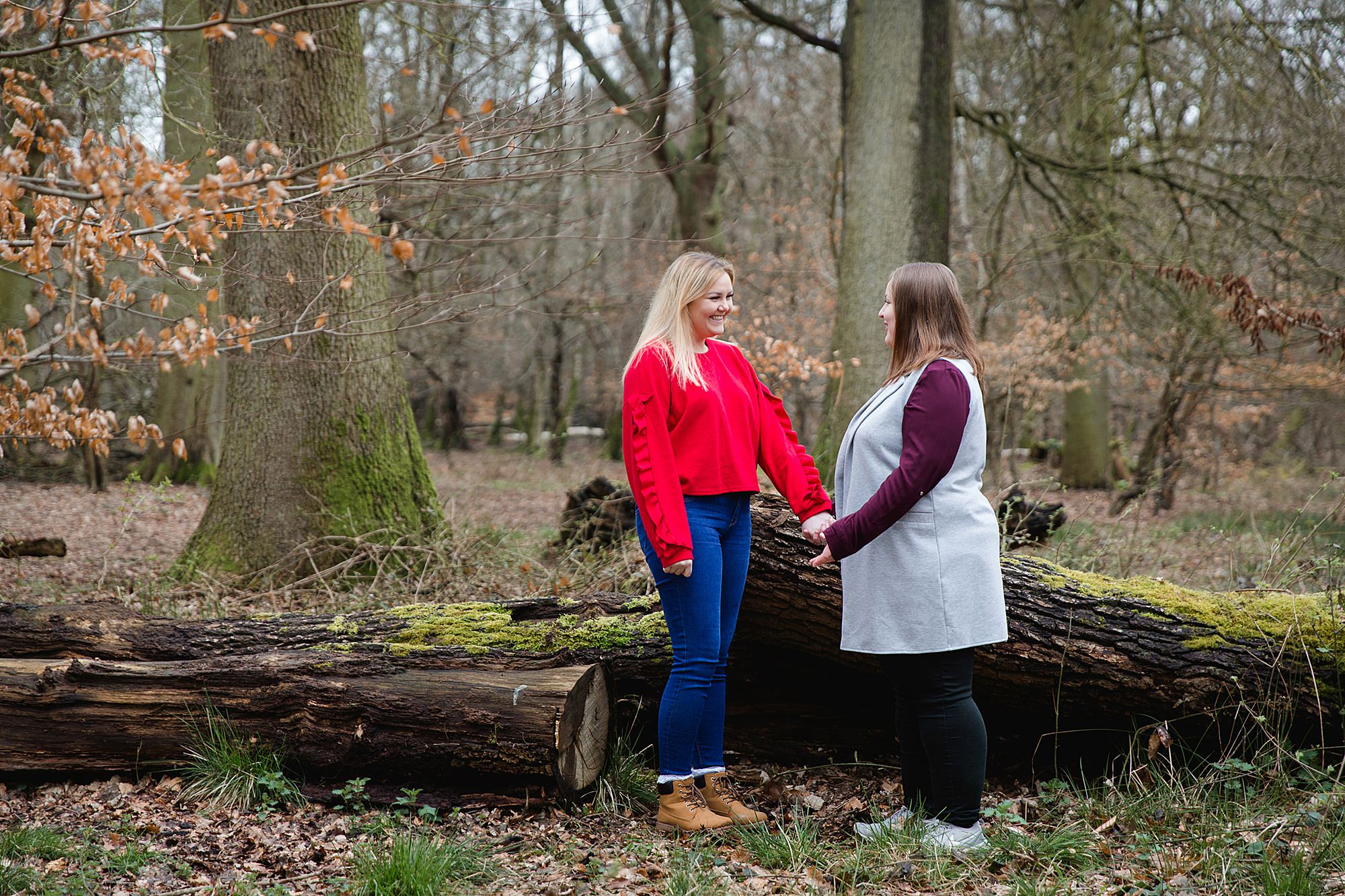 Ashridge park engagement shoot brides standing by tree