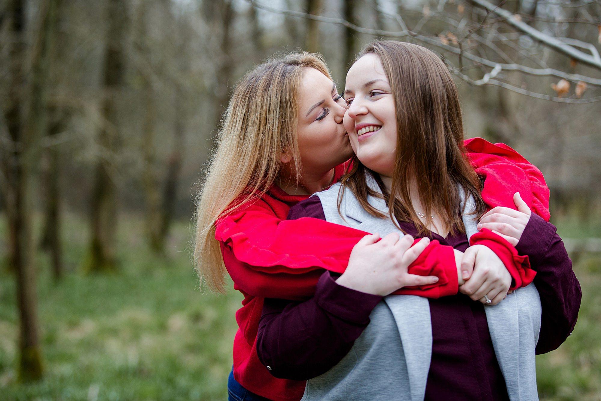 Ashridge park engagement shoot bride kisses her fiancee on cheek