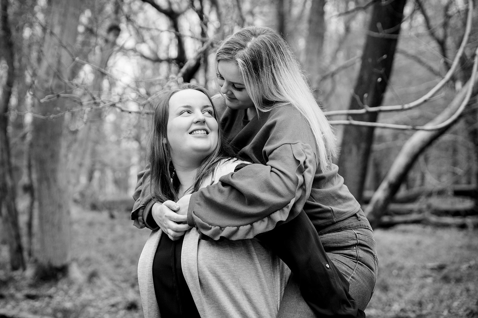 Ashridge park engagement shoot brides walking together brides piggyback