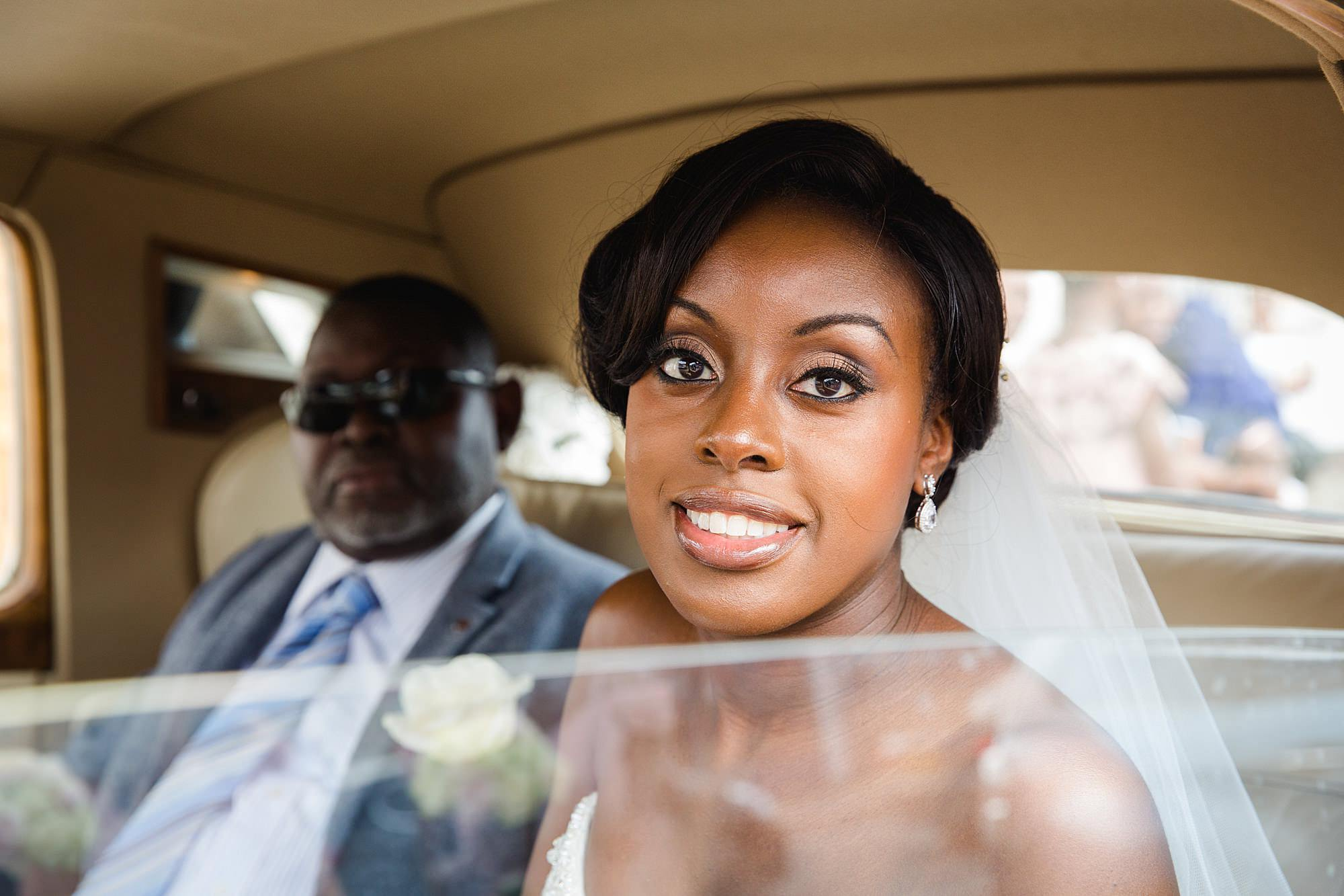 Bank of England Sports Centre wedding portrait of bride inside wedding car