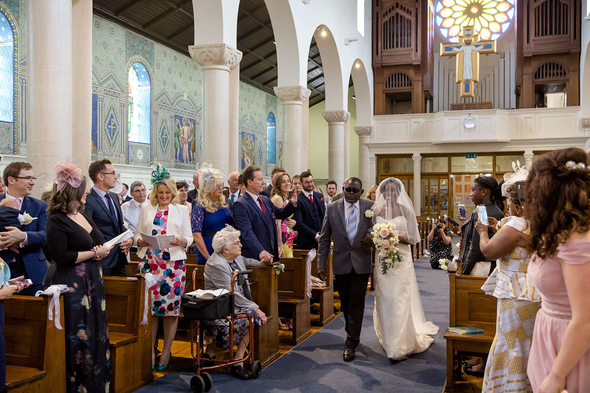 Bank of England Sports Centre wedding bride walks down aisle