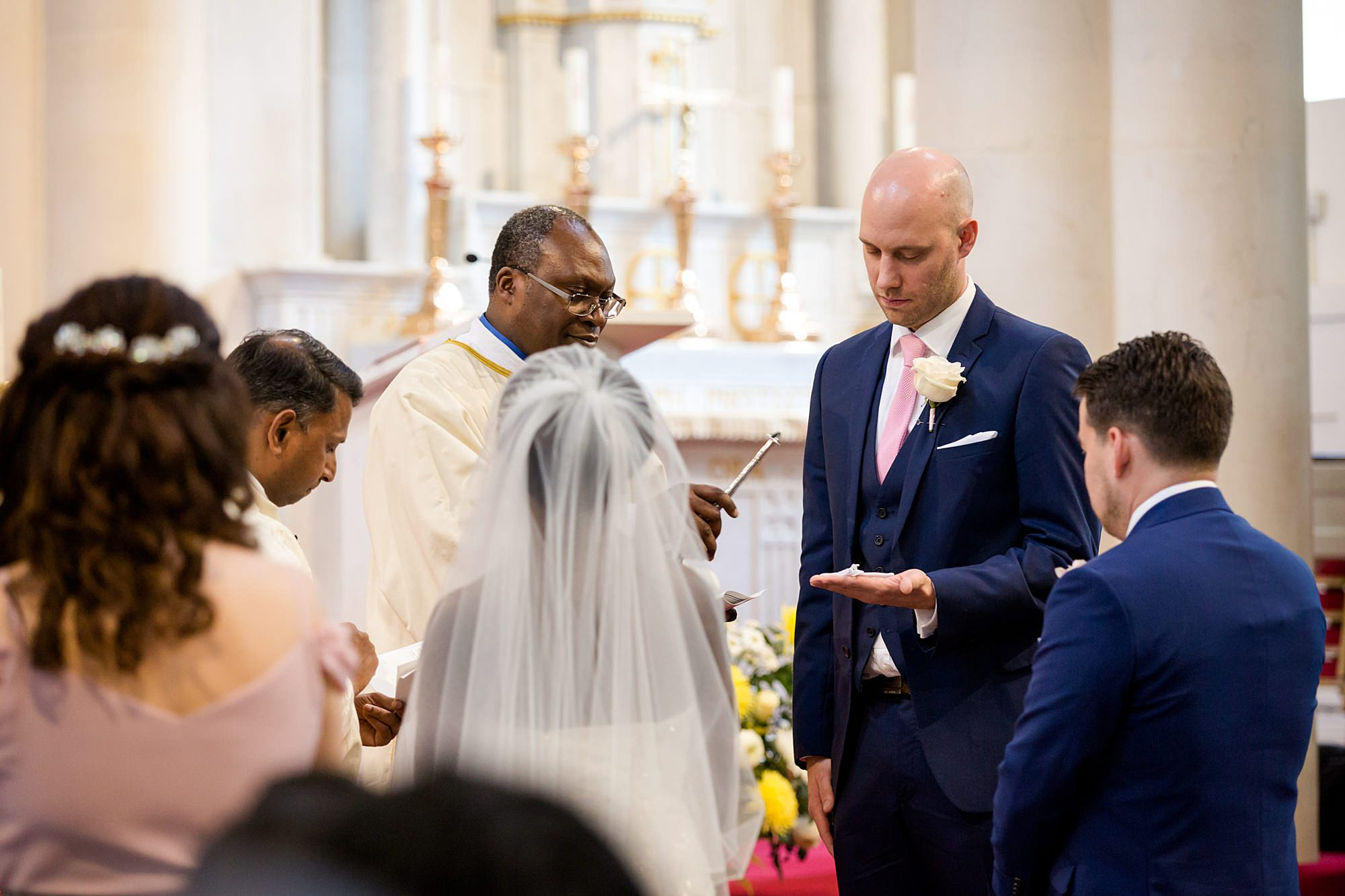 Bank of England Sports Centre wedding priest blesses rings