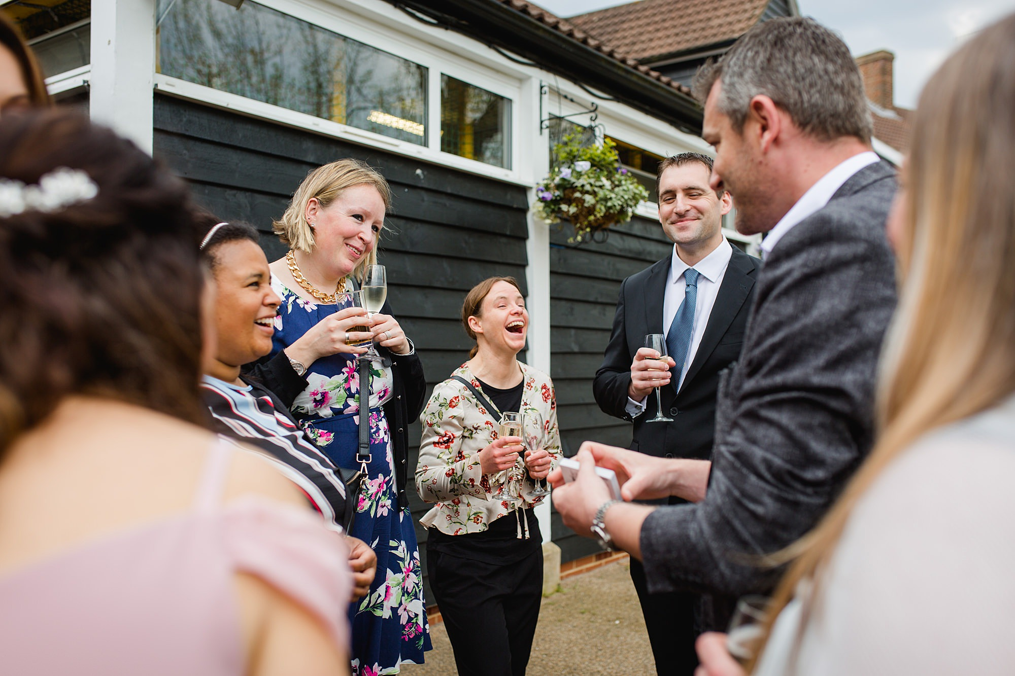 Bank of England Sports Centre wedding guests laugh at magician