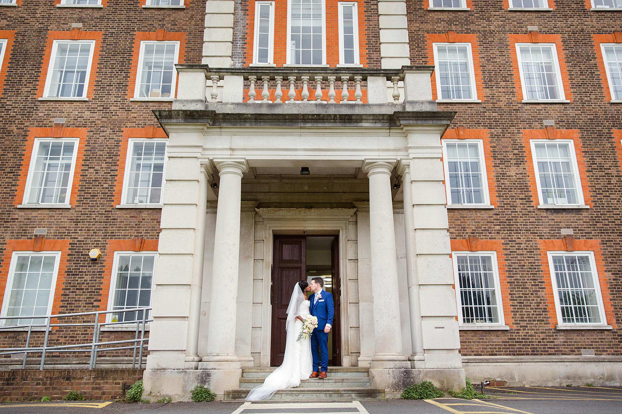 Bank of England Sports Centre wedding bride and groom in front of building