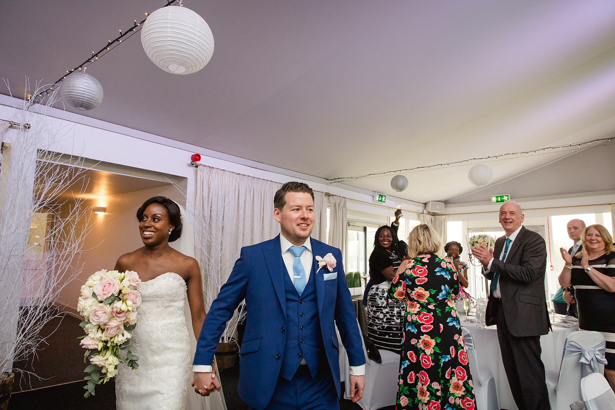 Bank of England Sports Centre wedding bride and groom enter for wedding breakfast