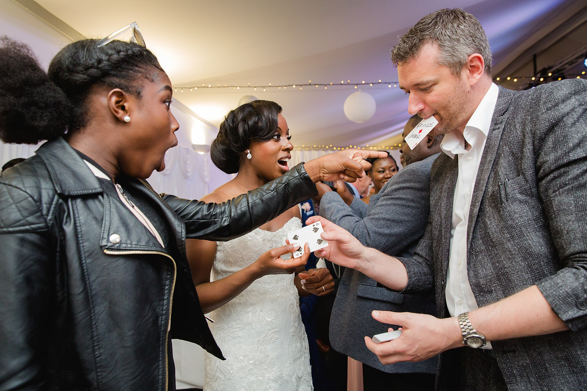 Bank of England Sports Centre wedding guests laughing at magician