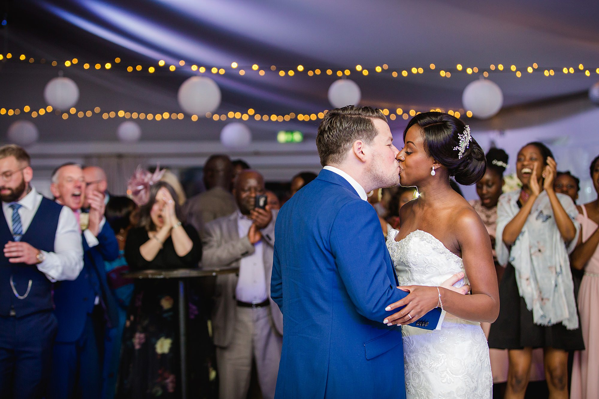 Bank of England Sports Centre wedding bride and groom kiss during first dance