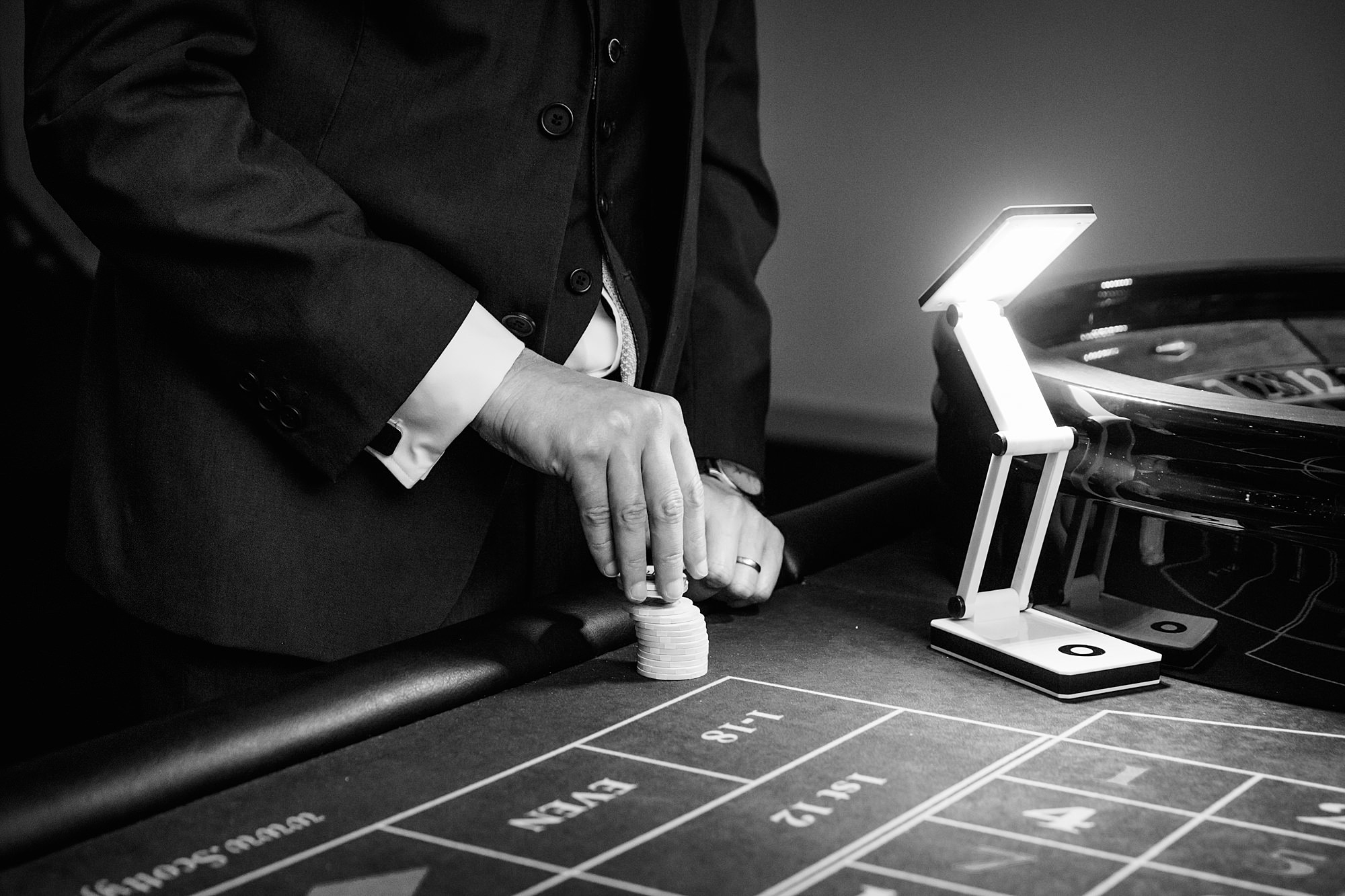 Bank of England Sports Centre wedding hand dealing at pop up wedding casino