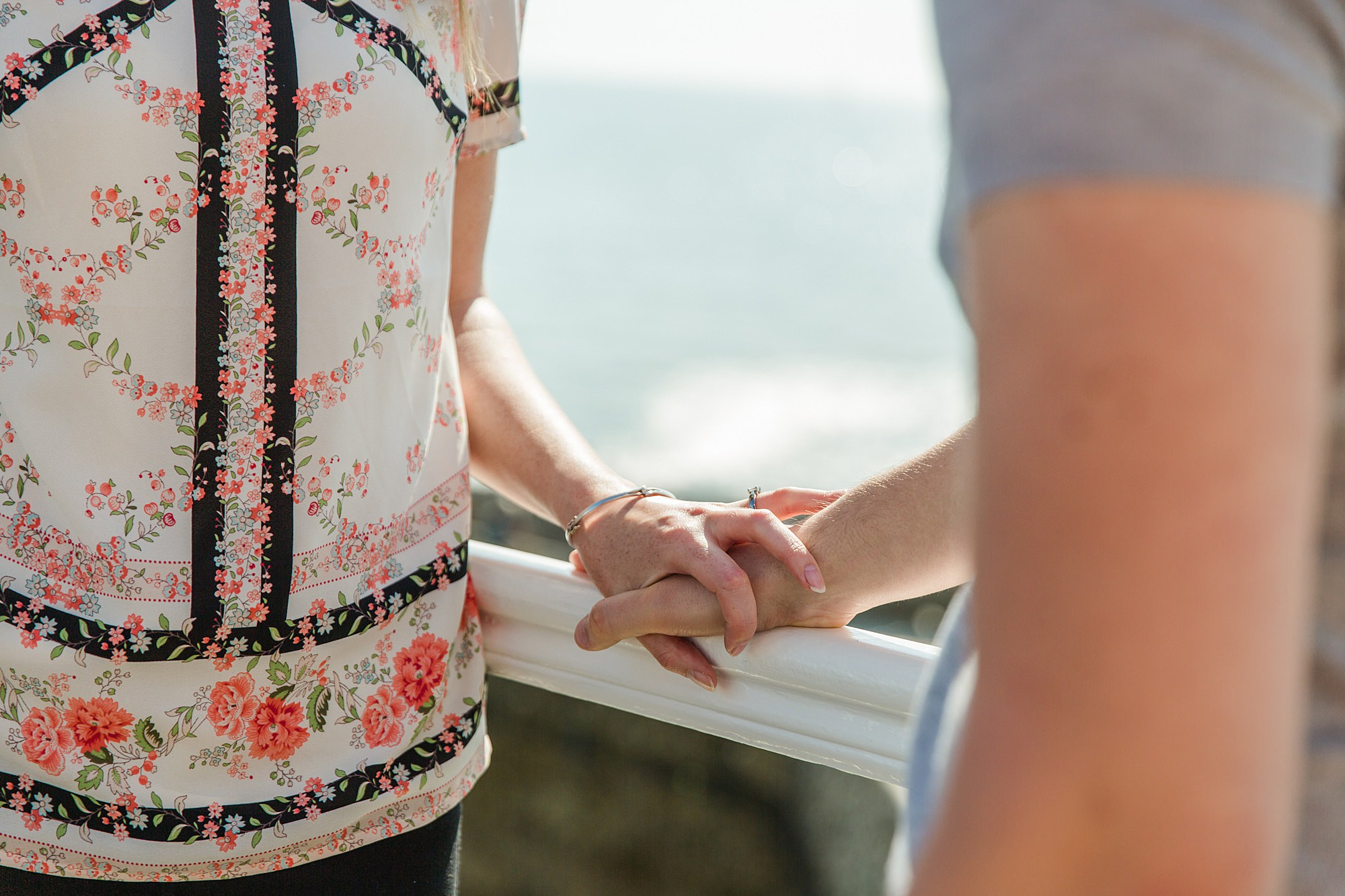 Fun Brighton engagement shoot close up detail of couple holding hands